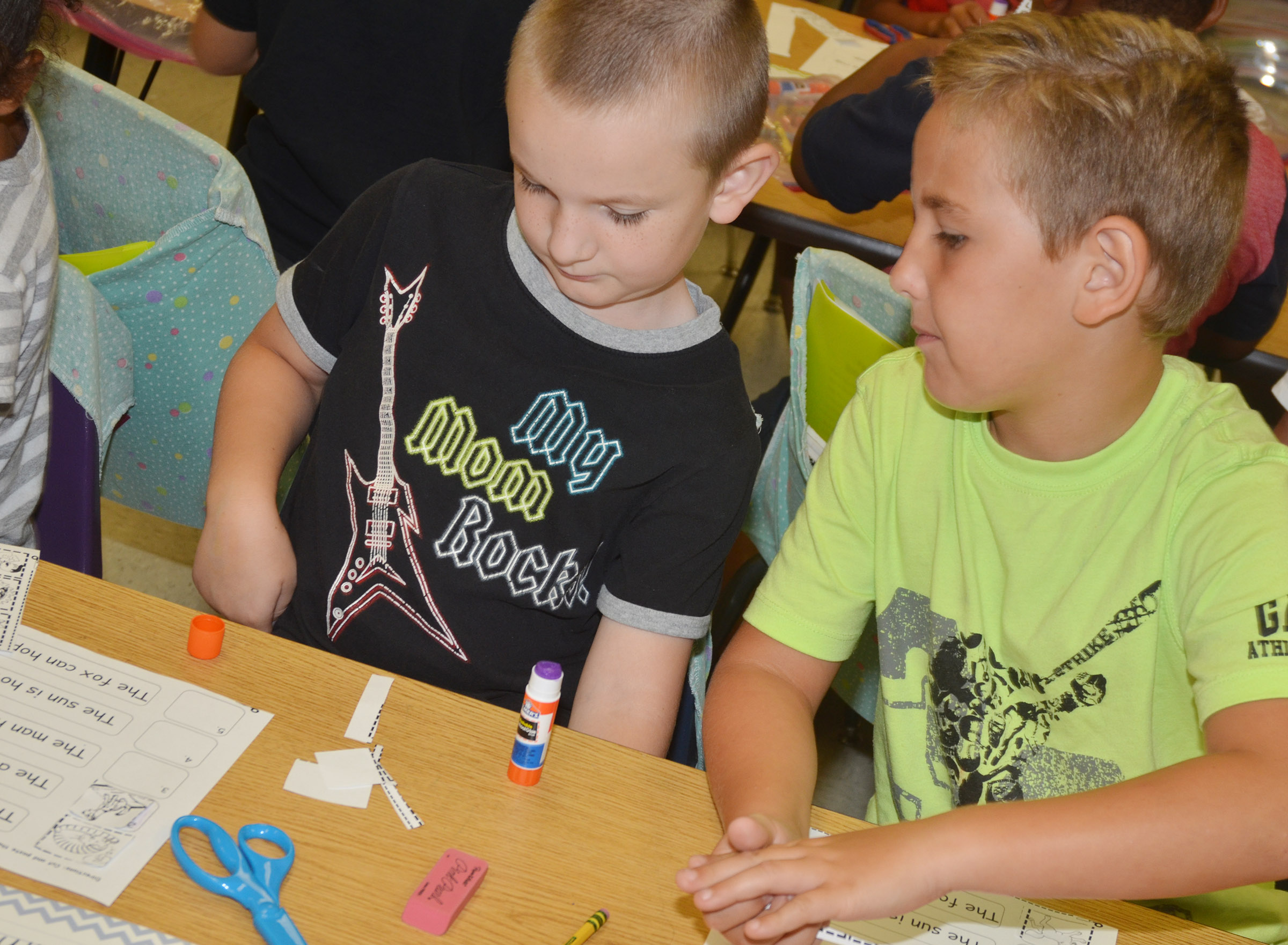 CES first-graders Ryne Gumm, at left, and Braxton Rhodes work on their worksheets.