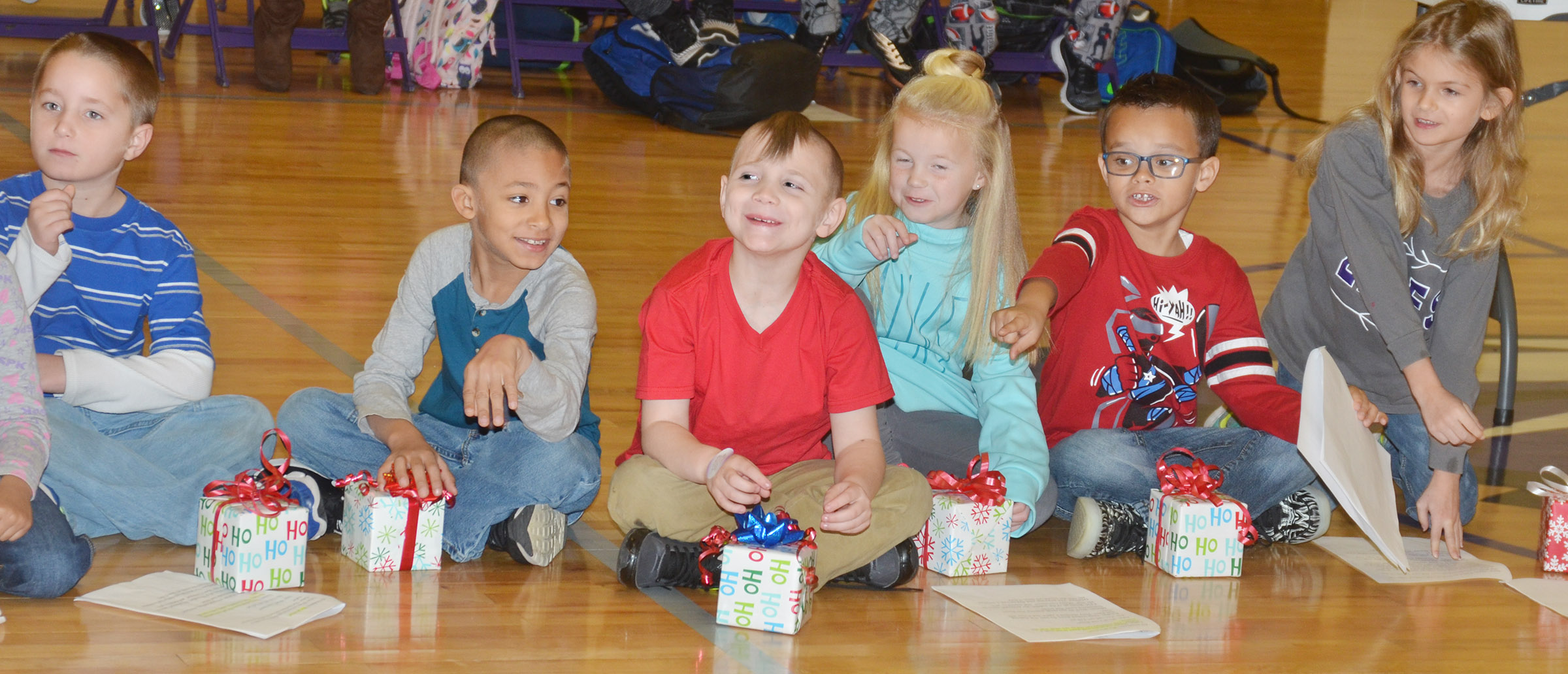 CES first-graders, from left, Kaiden Bradfield, Eli Williams, John Lane, Lillie Judd, Davian Taylor and Gracelyn Gebler laugh as they perform.