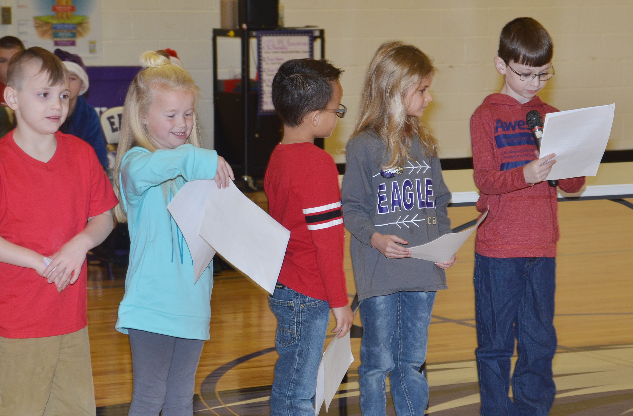 CES first-grader Parker Newton, at right, recites his lines.