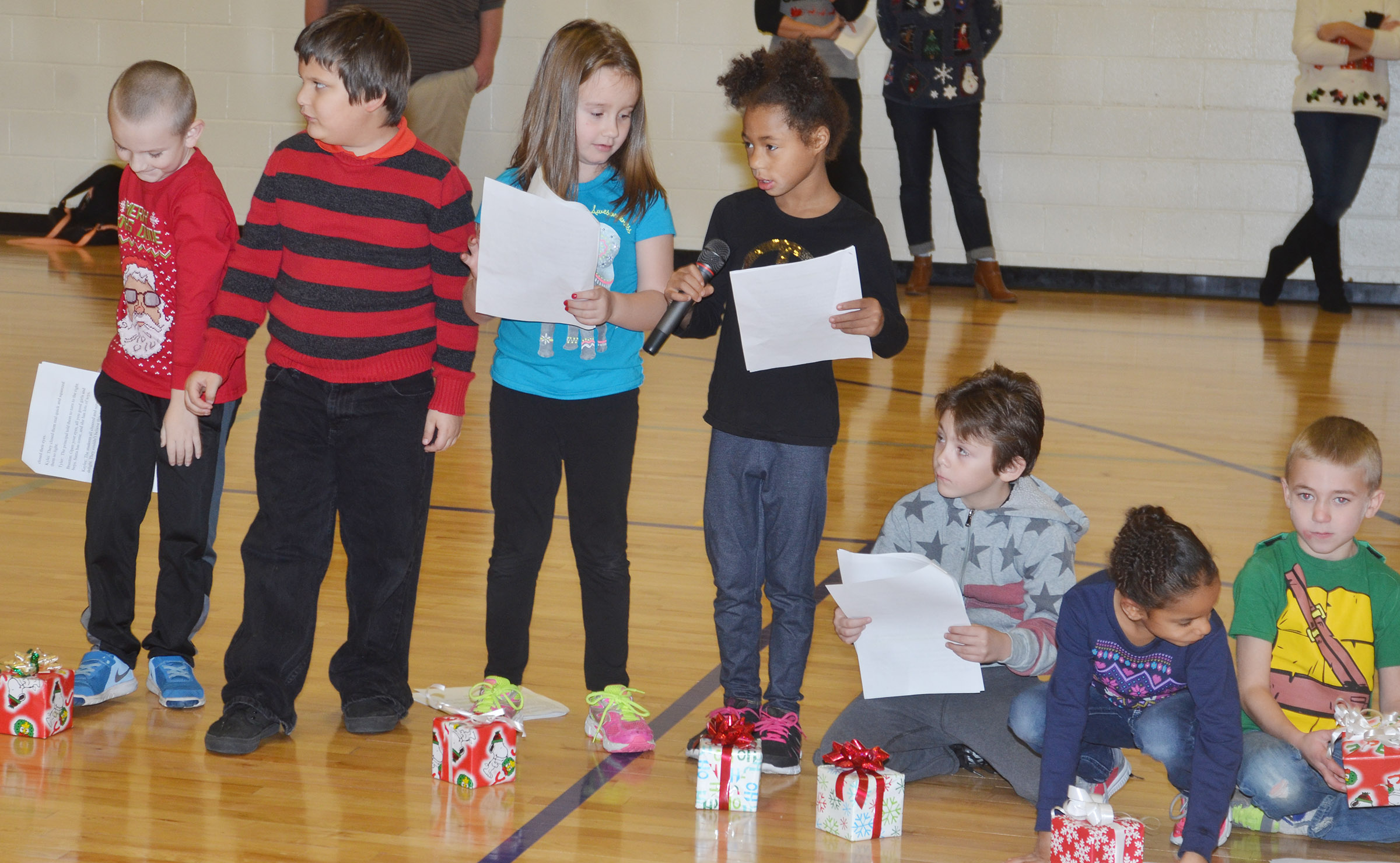 CES first-grader Brea Miller, center, recites her lines.