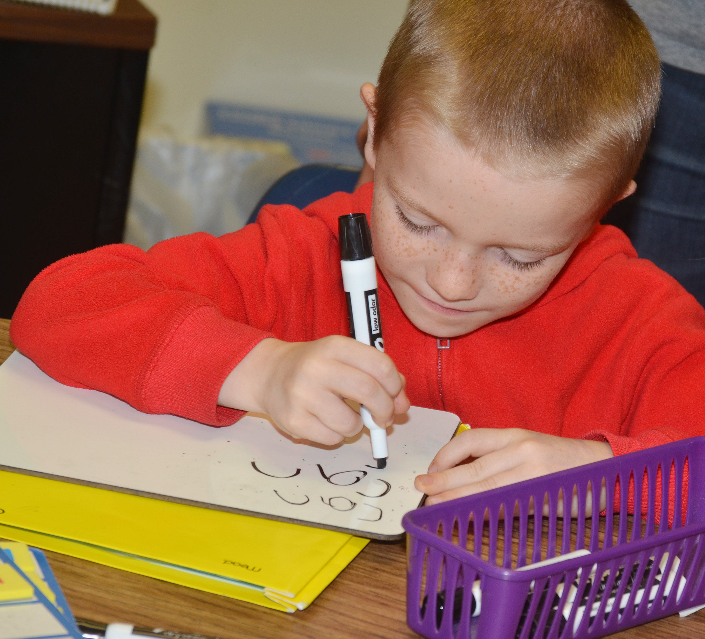 "CES first-grader Jason Eggers writes the word ""can."""