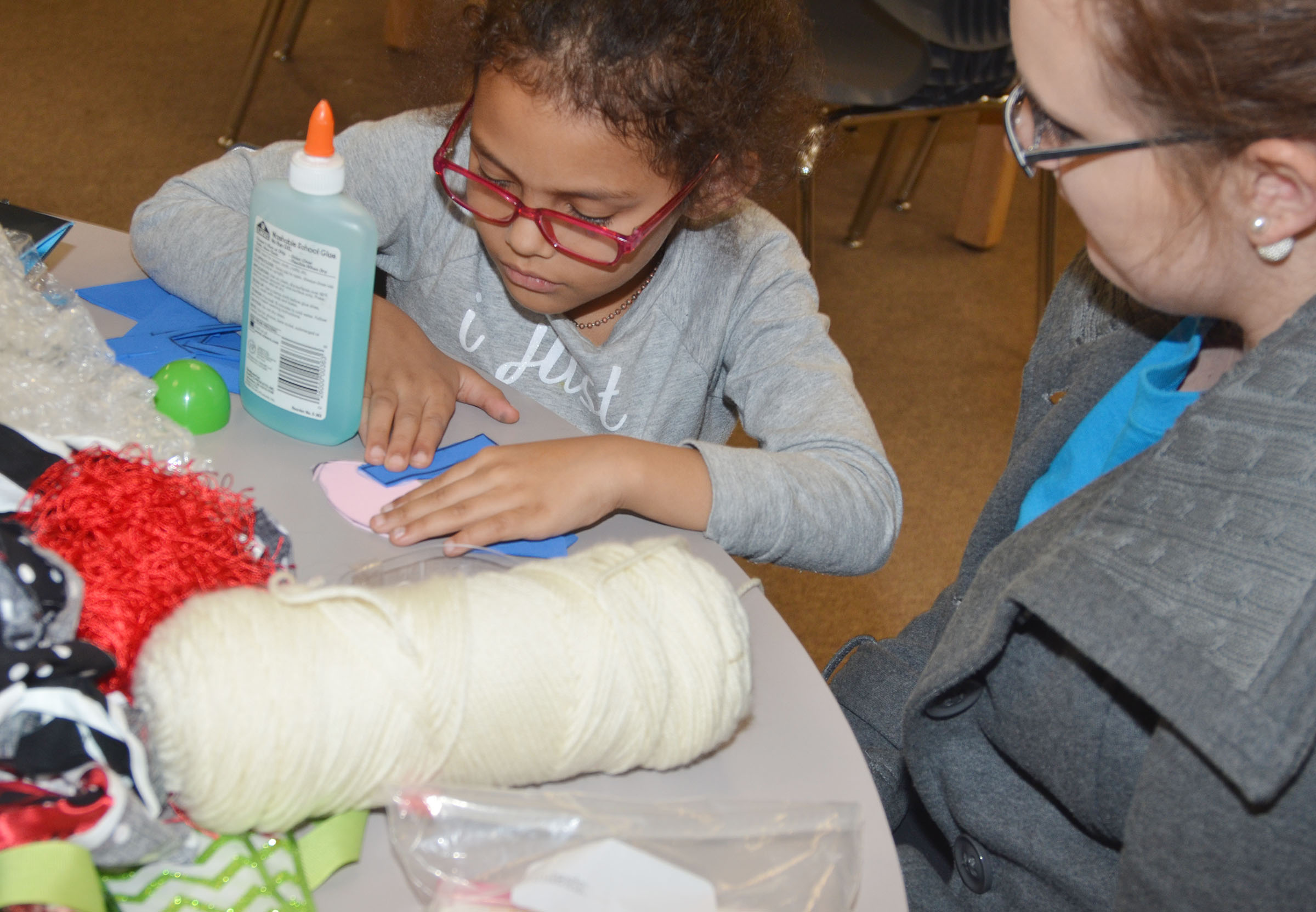 CES kindergartener Marlee Dickens makes a horse out of ordinary objects with CU early childhood education student Angel Burton.