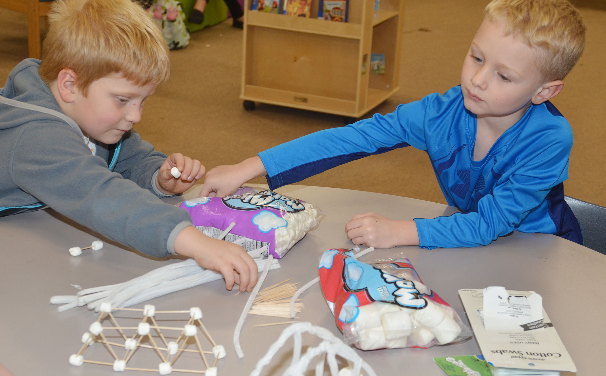 CES first-grader Ben Parrott, at left, and kindergartener Jackson Wright make bridges out of pipe cleaners, toothpicks and marshmallows.