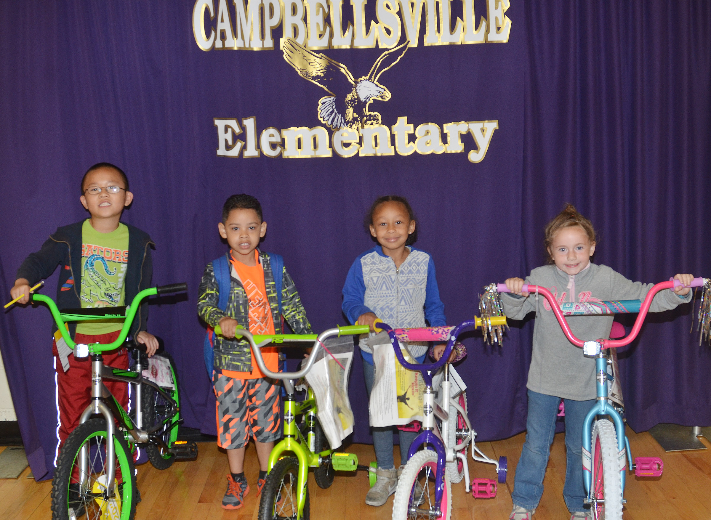 CES students, from left, second-grader Alex Yang, kindergarteners Demarcus Noyola and Elyzabeth Fisher and first-grader Kinsley Graham received bicycles for their good behavior and classroom leadership skills this school year.