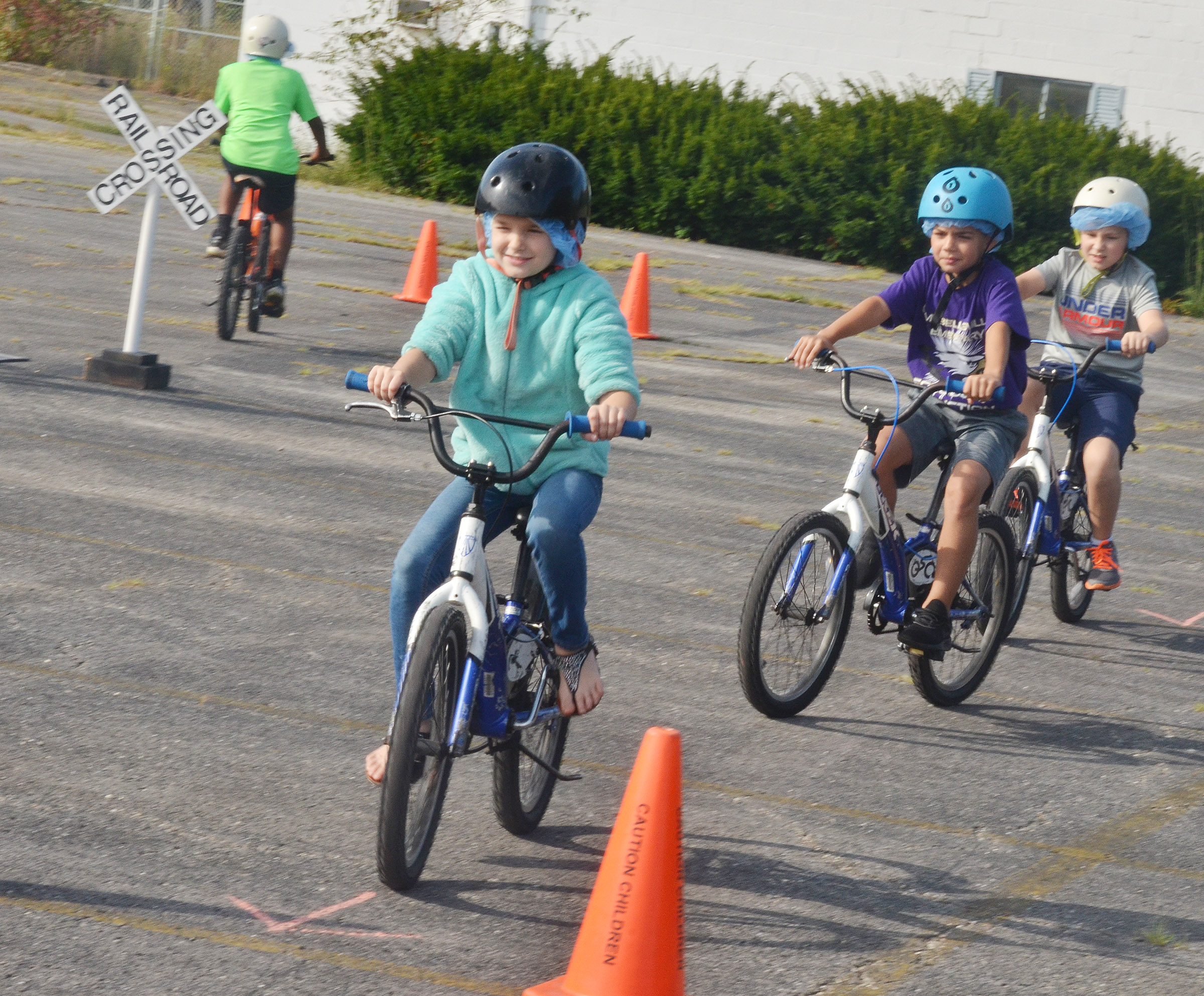 CES fourth-graders, from left, Destiny Abell, Easton Williams and Grayson Dooley obey bicycles rules.