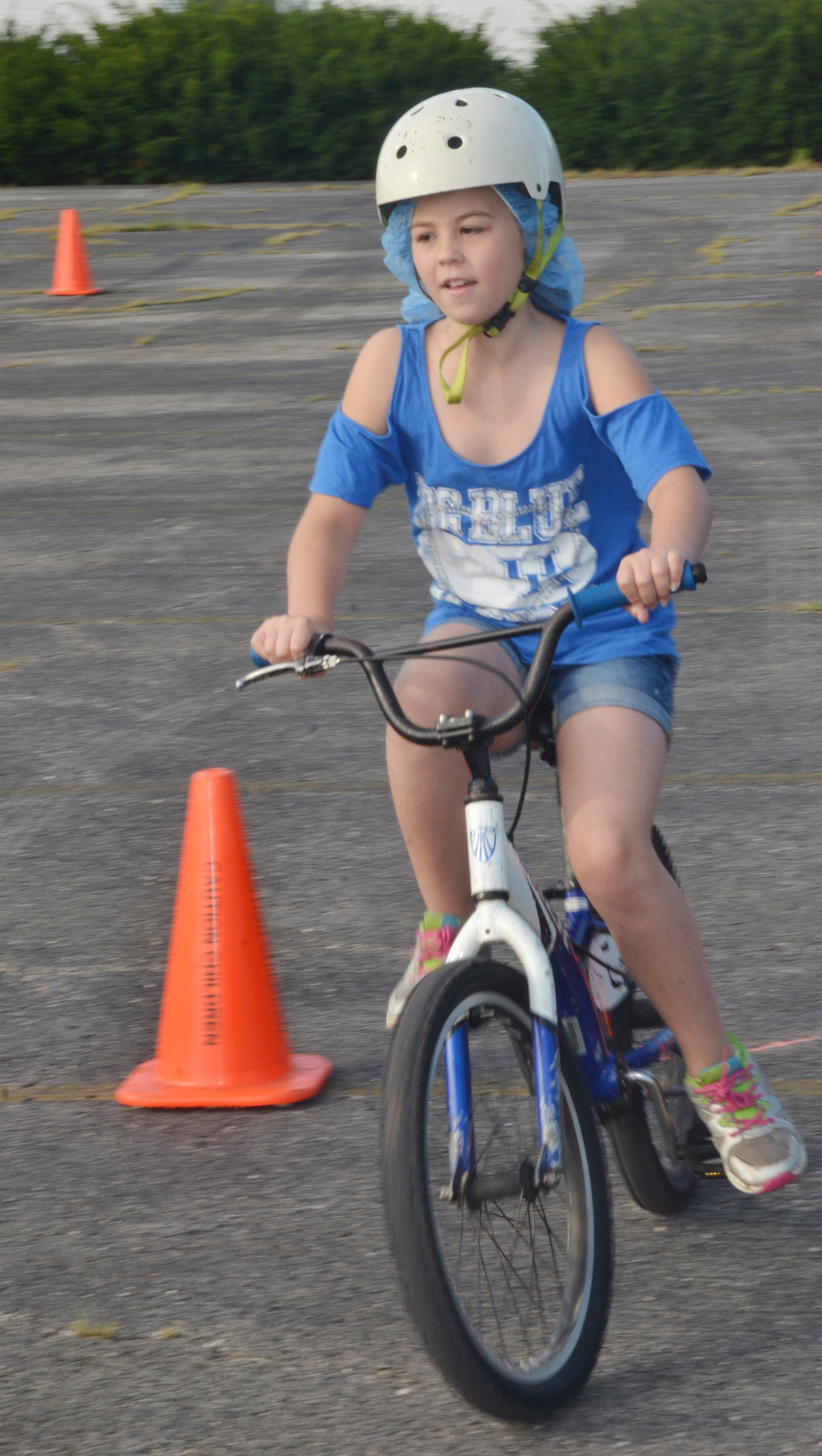 CES fourth-grader Chloe Bates rides her bike through the obstacle course.