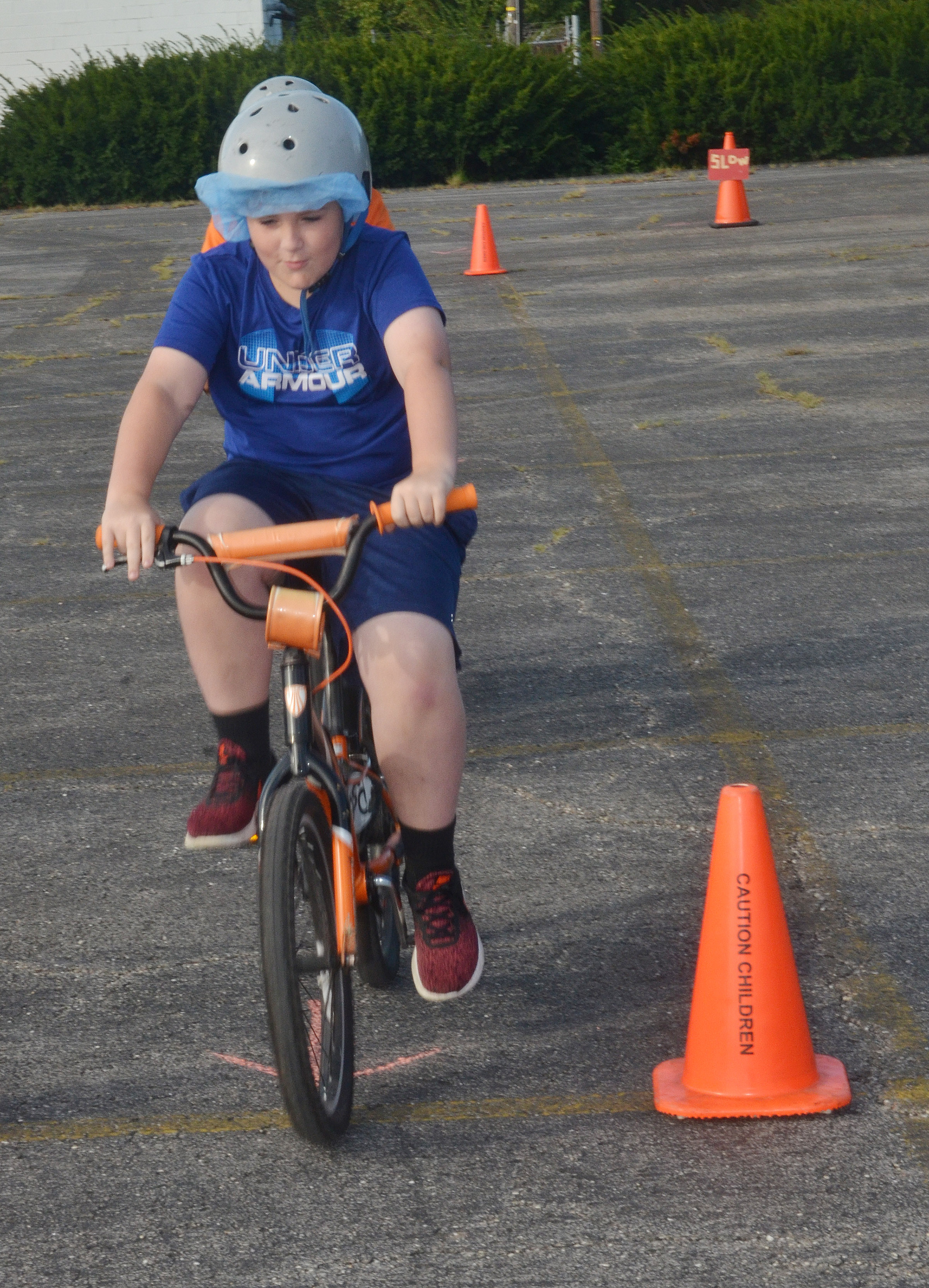 CES fourth-grader Ethan Garrison rides his bike through the obstacle course.