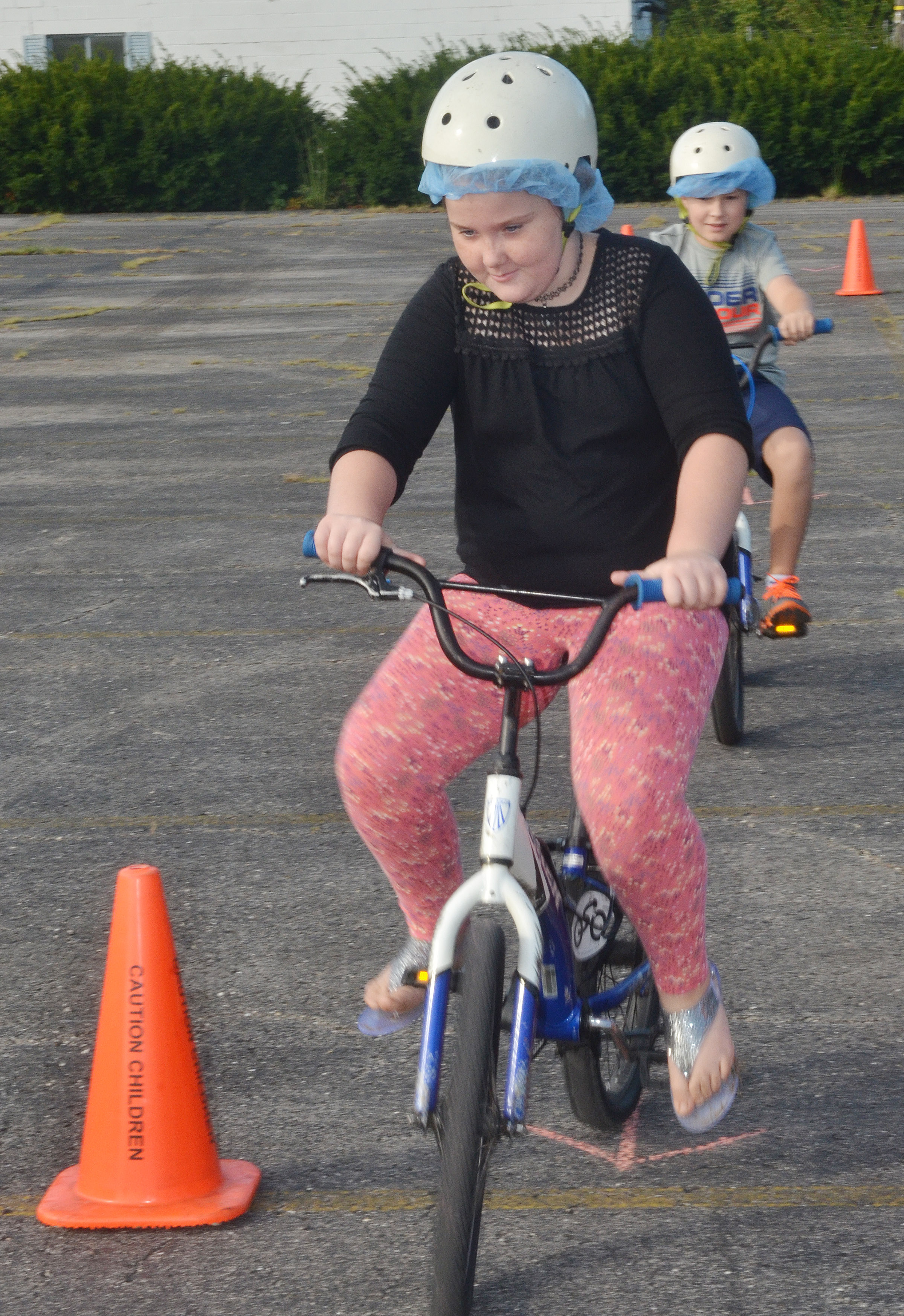 CES fourth-grader Madison Philpott rides her bike through the obstacle course.