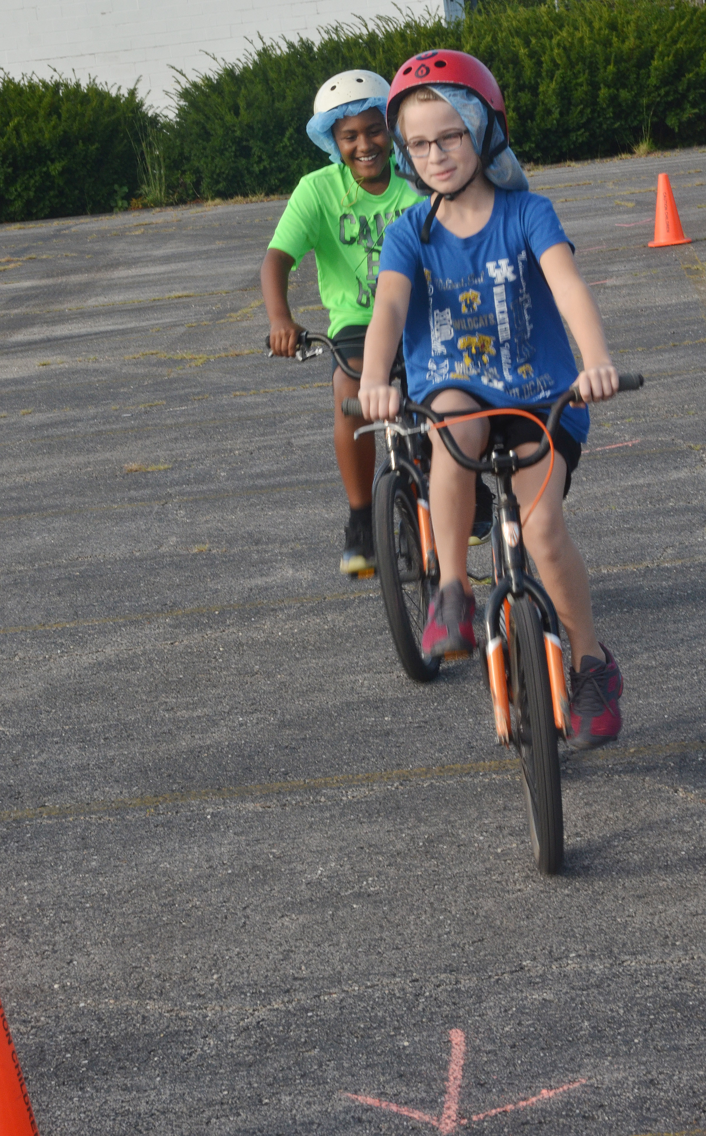 CES fourth-graders Shaiden Calhoun, at left, and Raegan Hayes ride through the obstacle course.