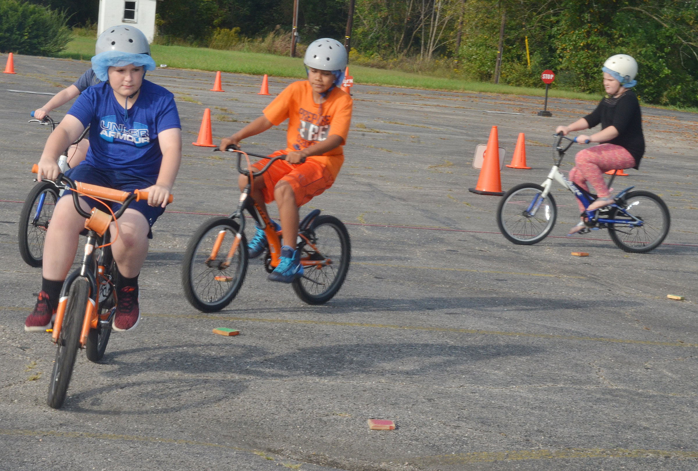 CES fourth-grader Ethan Garrison leads his classmates while driving in a circle and obeying bicycle rules.