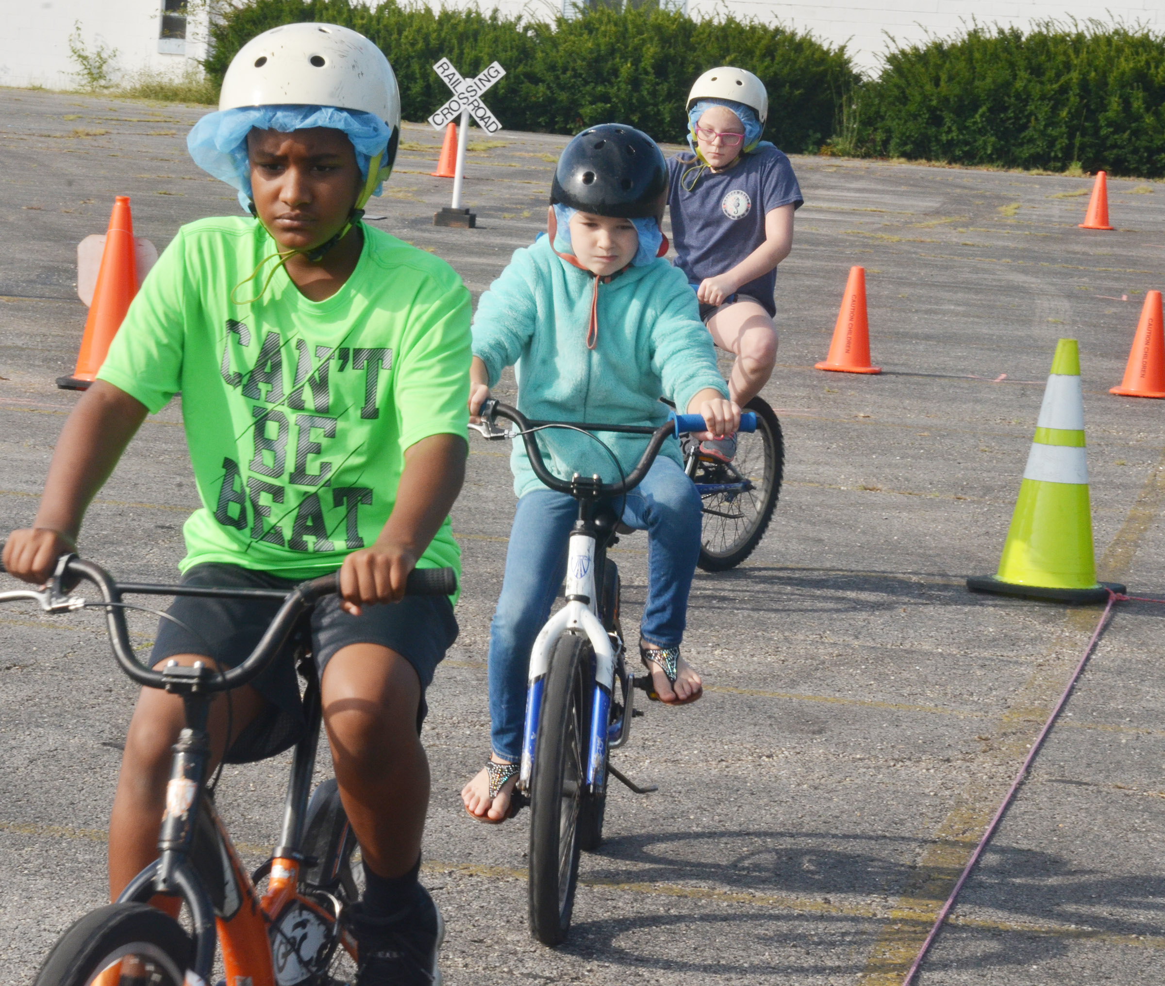 CES fourth-graders, from left, Shaiden Calhoun, Destiny Abell and Jaylen Clark obey bicycle rules.