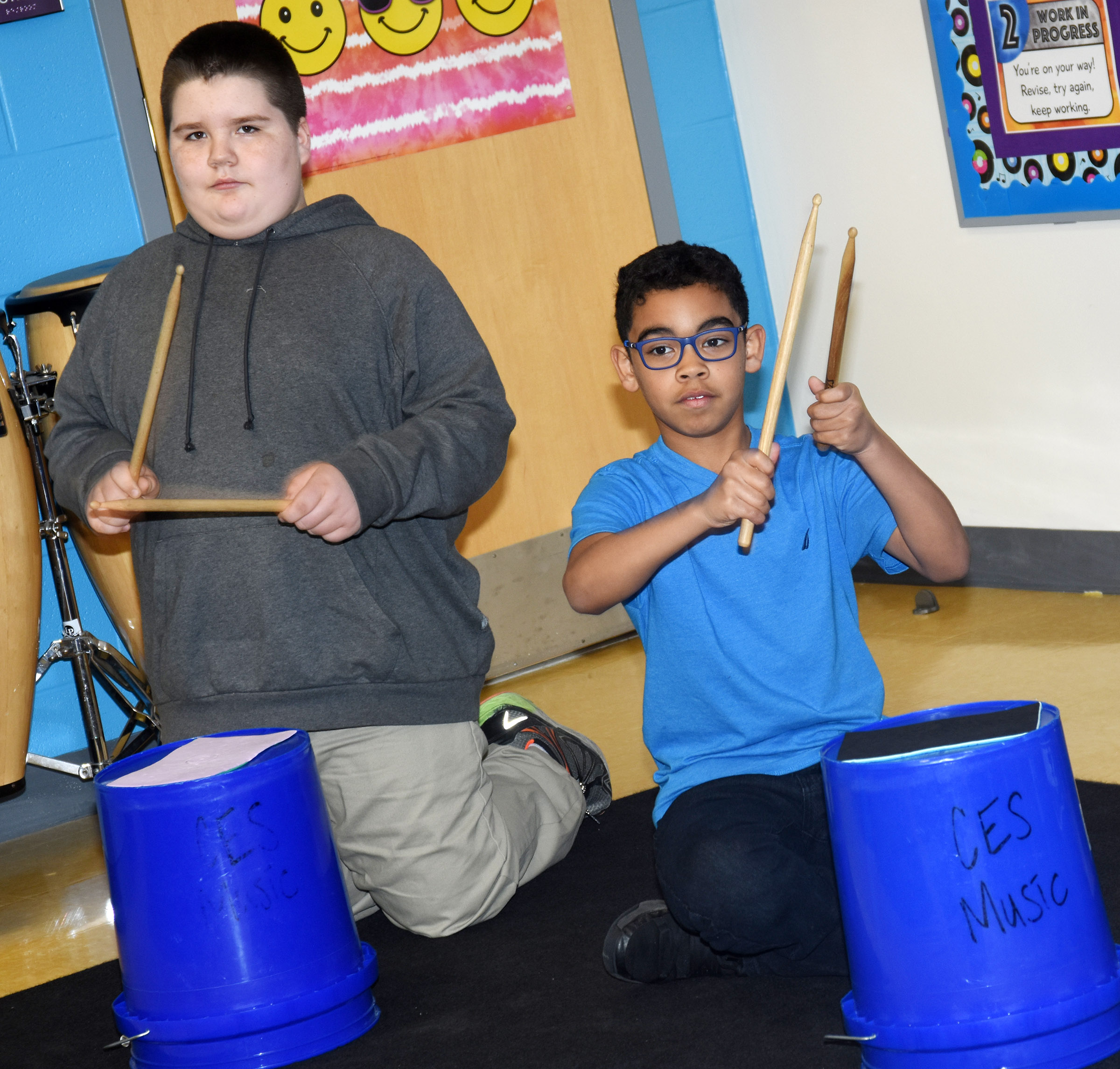 CES fifth-graders Joseph Gutierrez, at left, and Gabriel Noyola play the bucket drums.