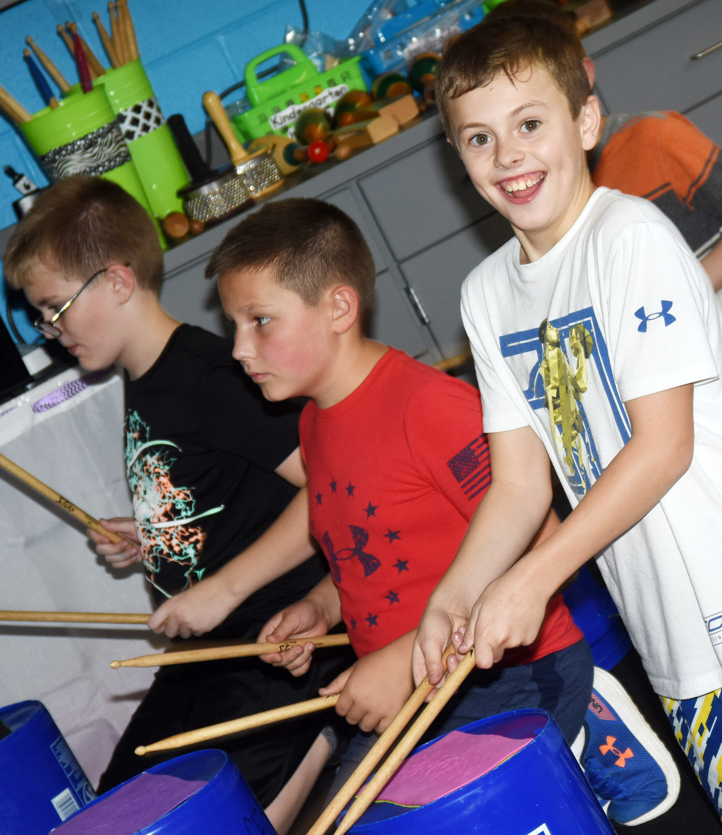 CES fifth-grader Keaton Hord smiles as he plays the drums with his classmates.