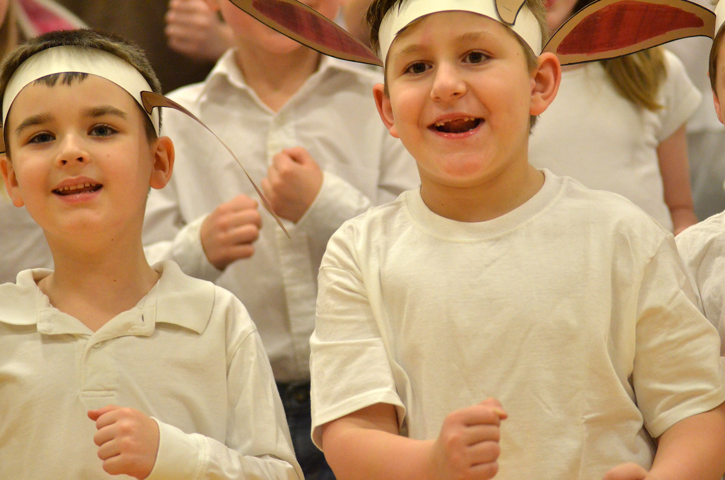 CES first-graders Sawyer Lange, at left, and Tommy Caswell sing.