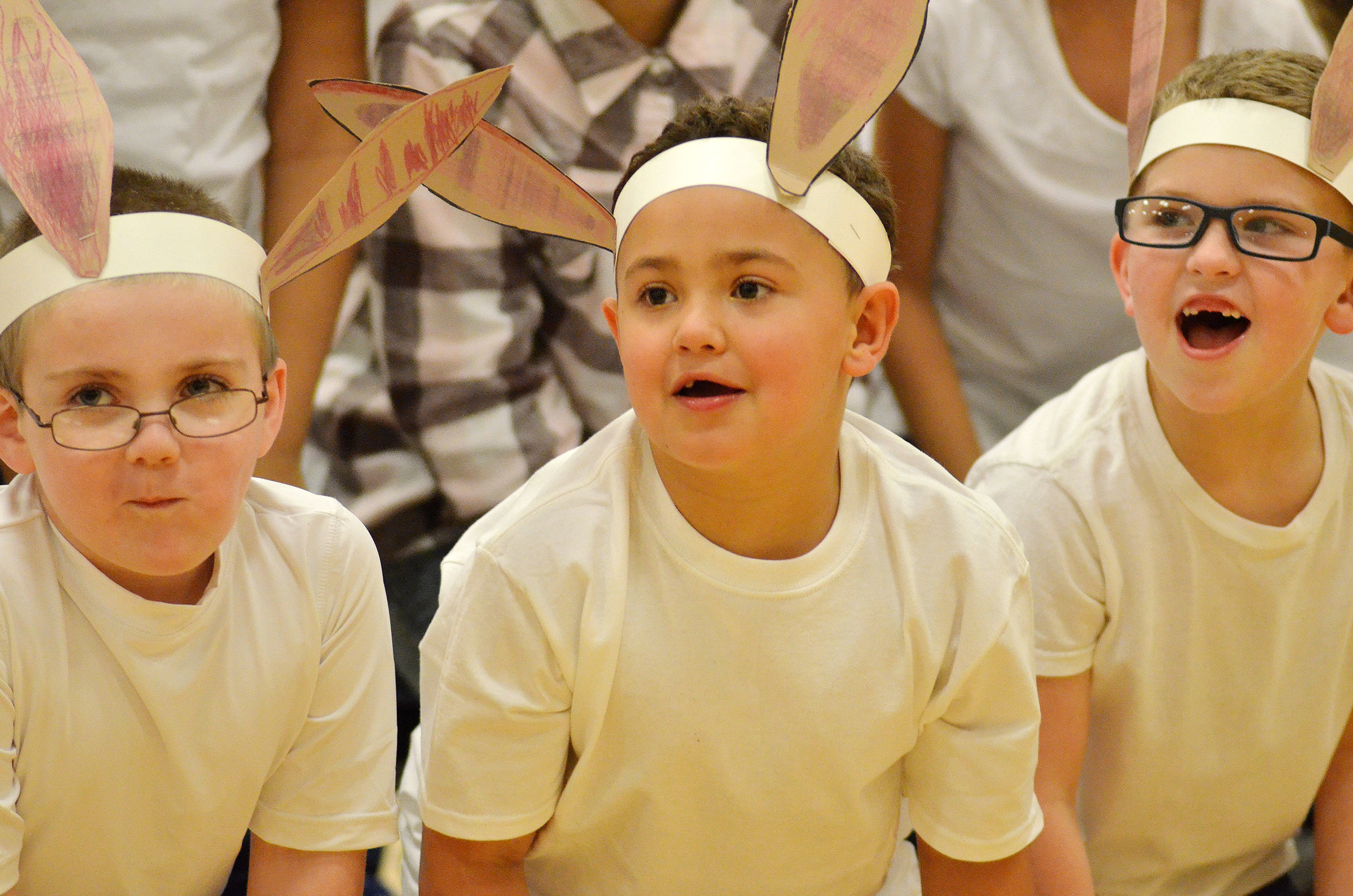 "From left, CES first-graders Drake Edwards, Marion Mann and Ethan Bailey sing ""Bunny Ears."""