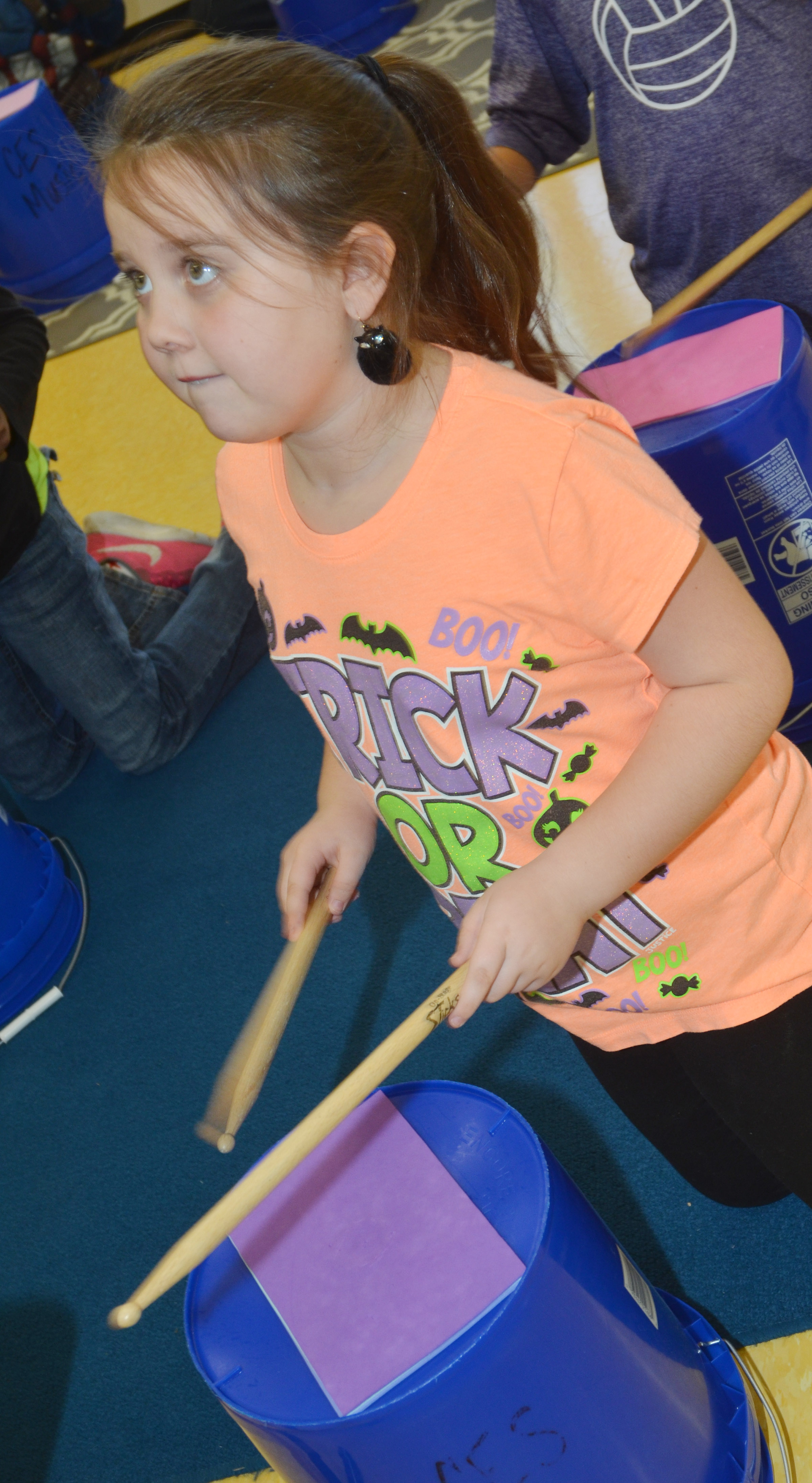 CES fourth-grader Maylee Wilds plays the bucket drums.
