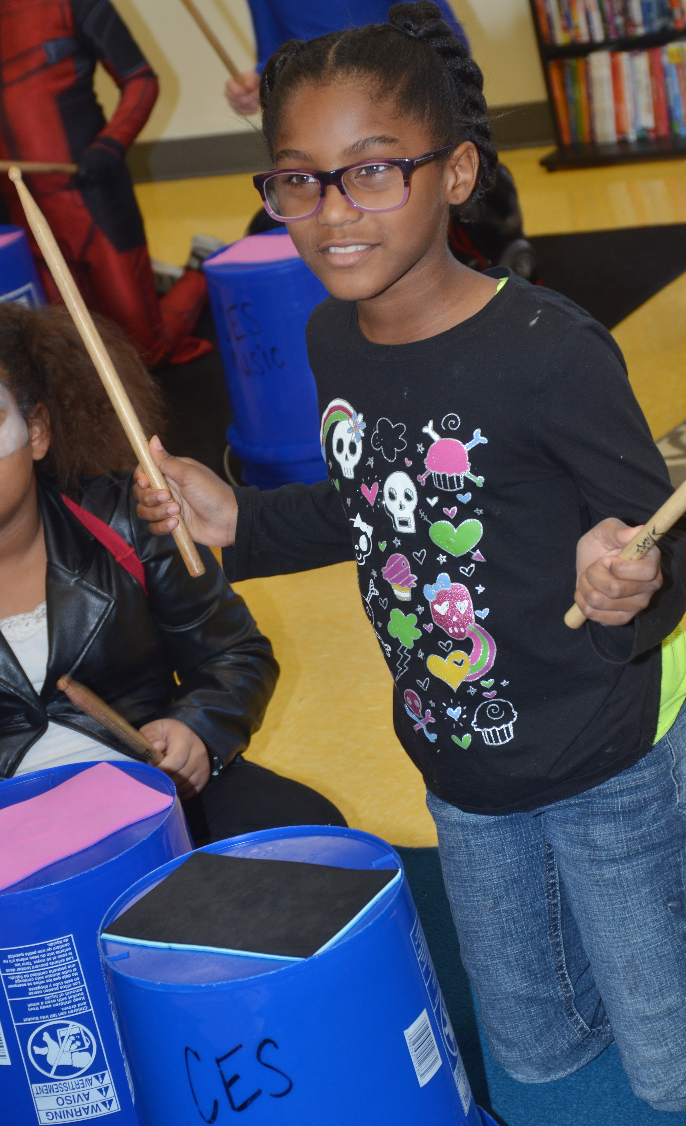 CES fourth-grader Maliyah Harris plays the bucket drums.