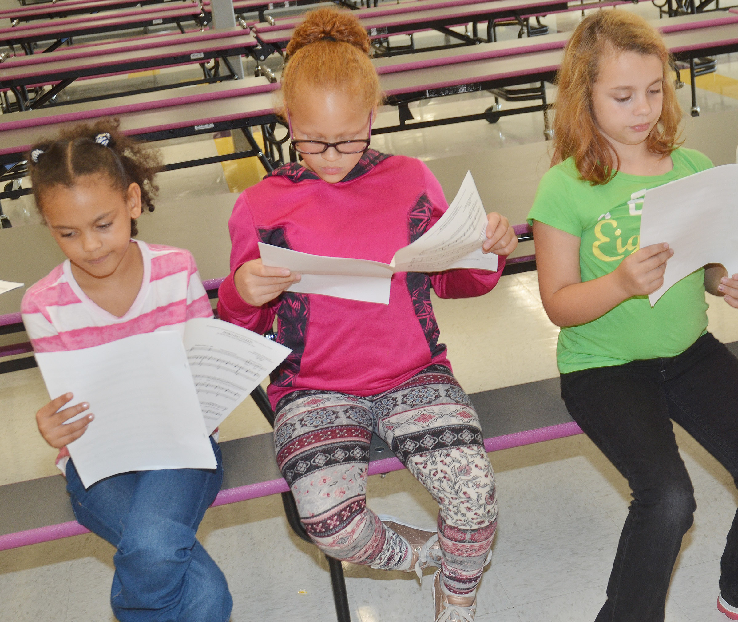 From left, CES third-graders Alexia Howard, Kallie Taylor and Angelina Babbs sing.