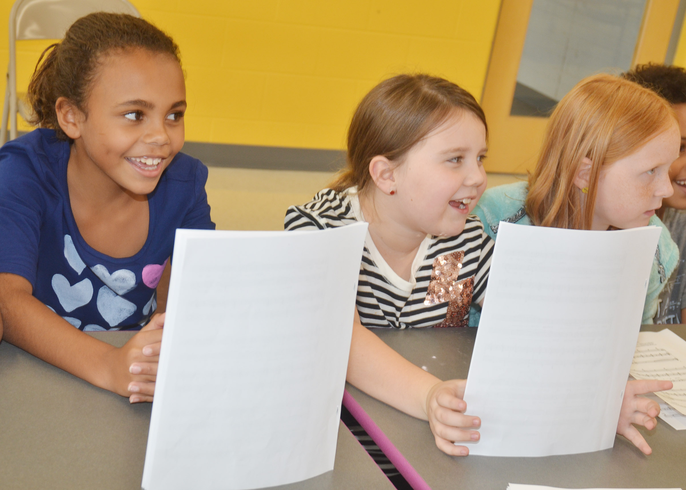 From left, CES third-grader Braelyn Taylor and fourth-graders Maylee Wilds and Nora Harris sing.