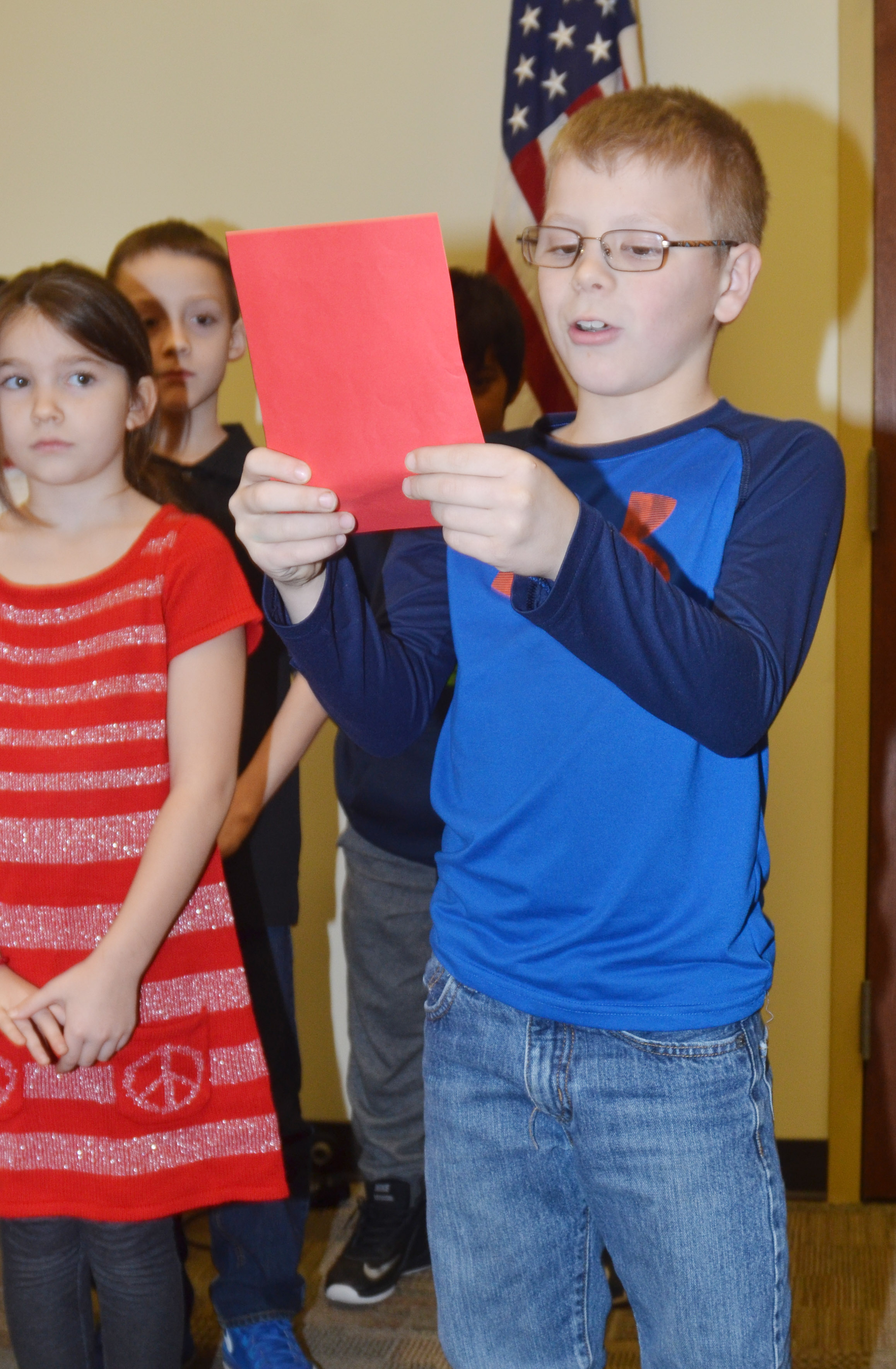 CES third-grader Ethan Irwin reads a poem.