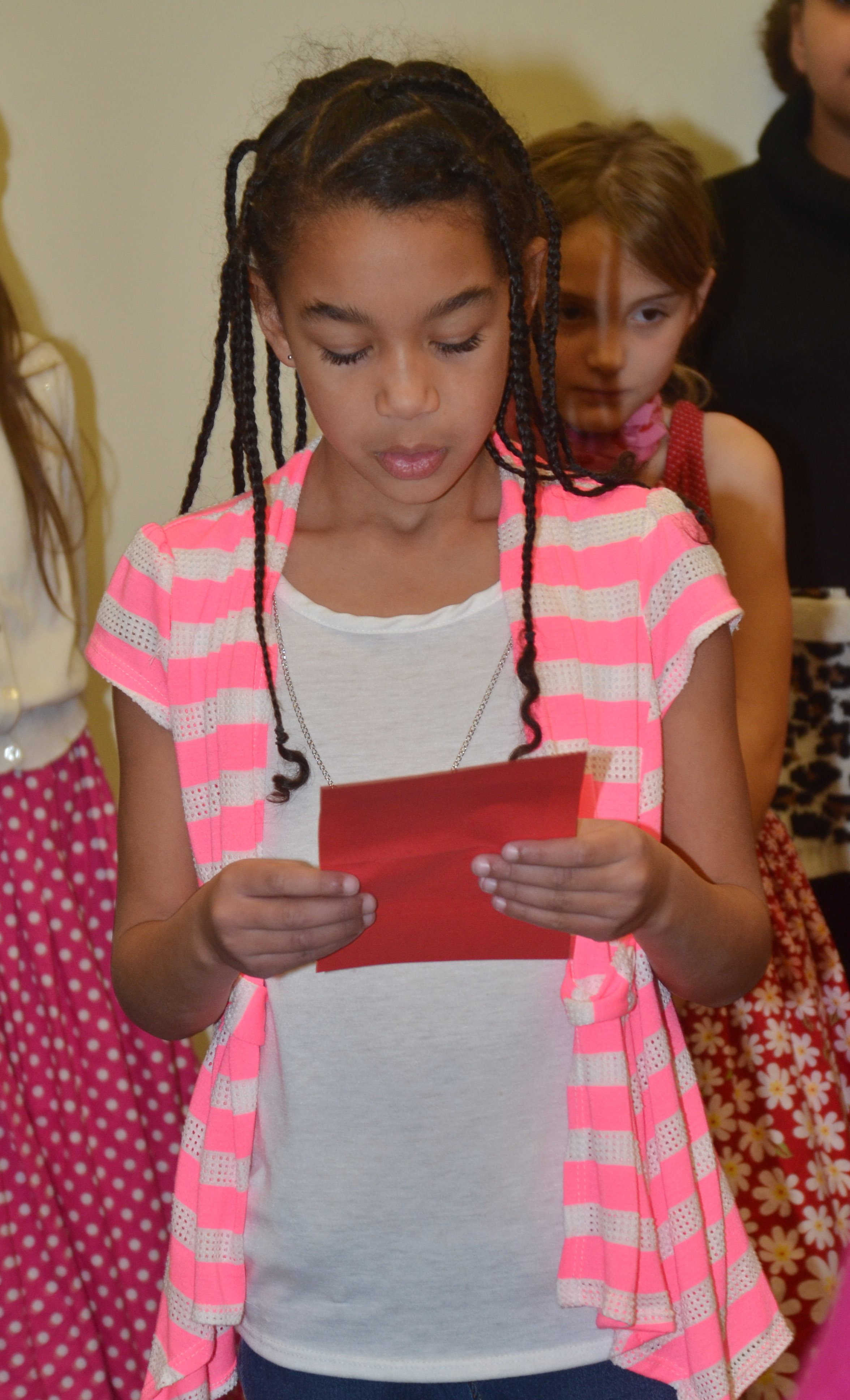 CES third-grader De'Asia Fisher reads a poem.