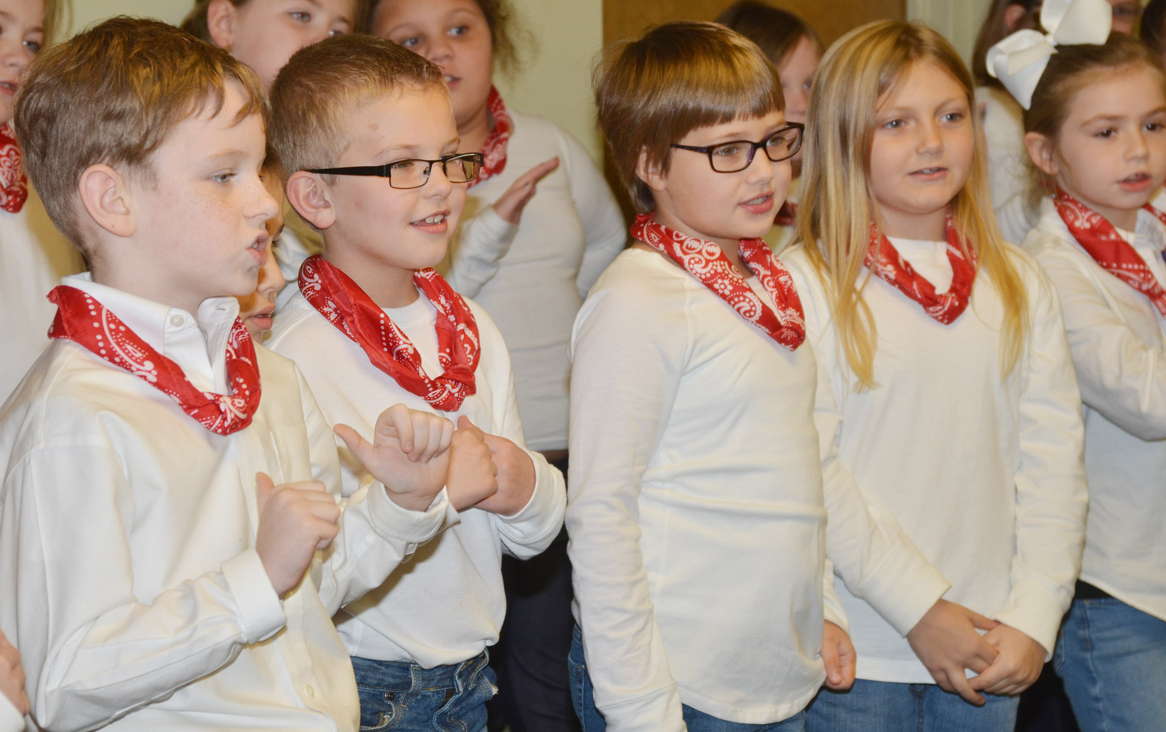 CES second-grade choir members, from left, Jayden Cox, Ethan Bailey, Addelyn Dooley, Asia Singleton and Lainey Price sing.
