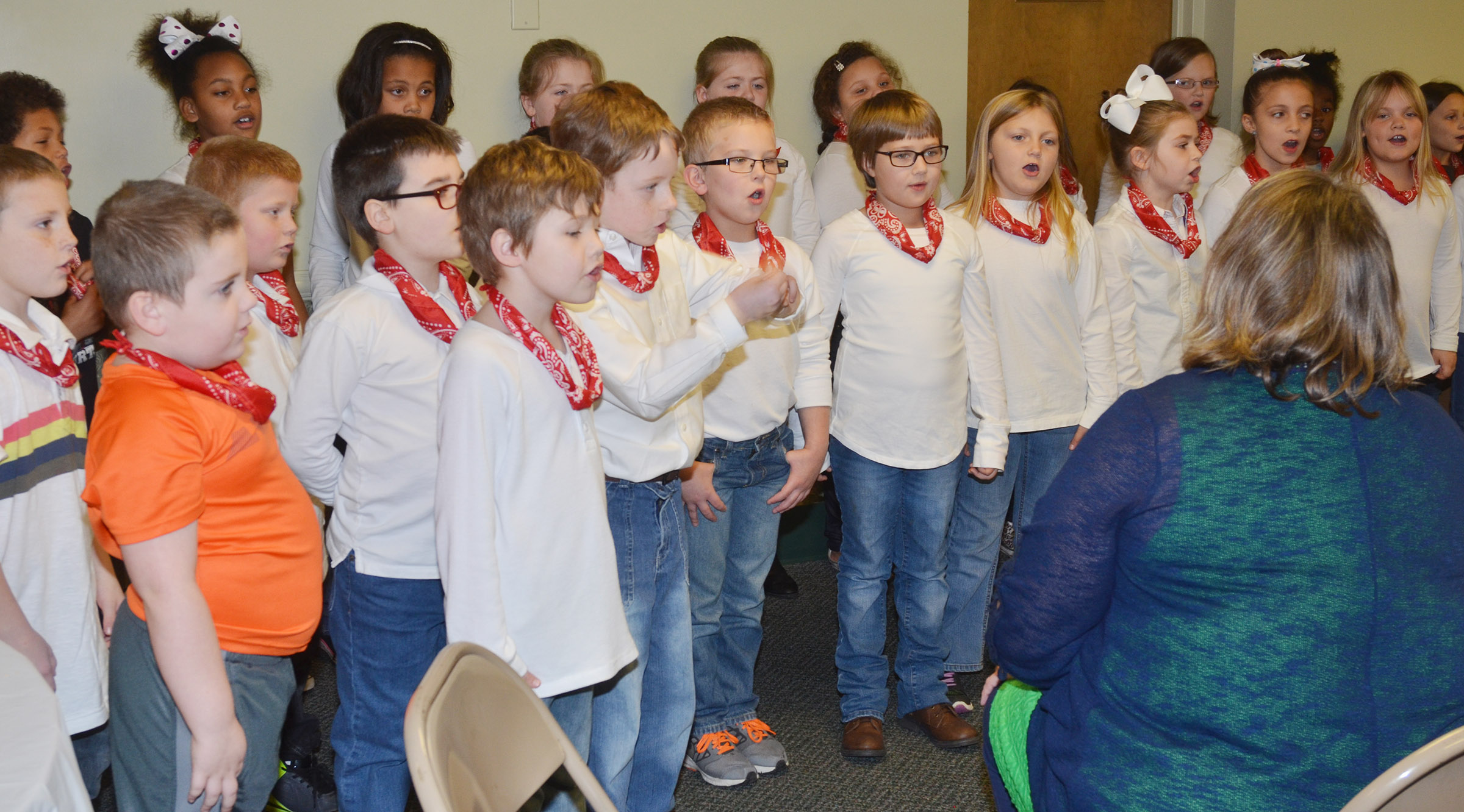 CES second-grade choir members sing as music teacher Cyndi Chadwick directs.