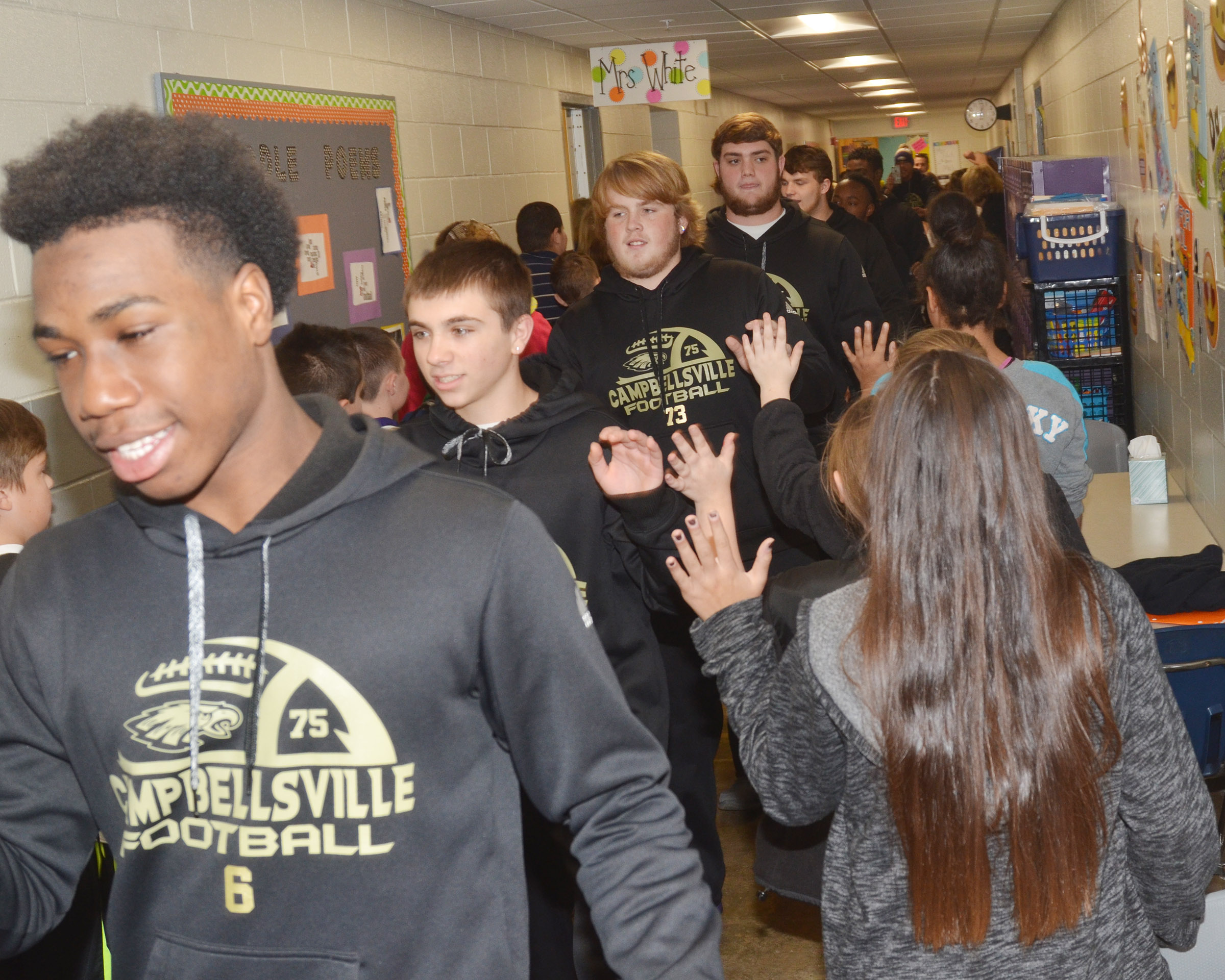 CHS sophomore Malachi Corley leads his teammates down the CES hallway.
