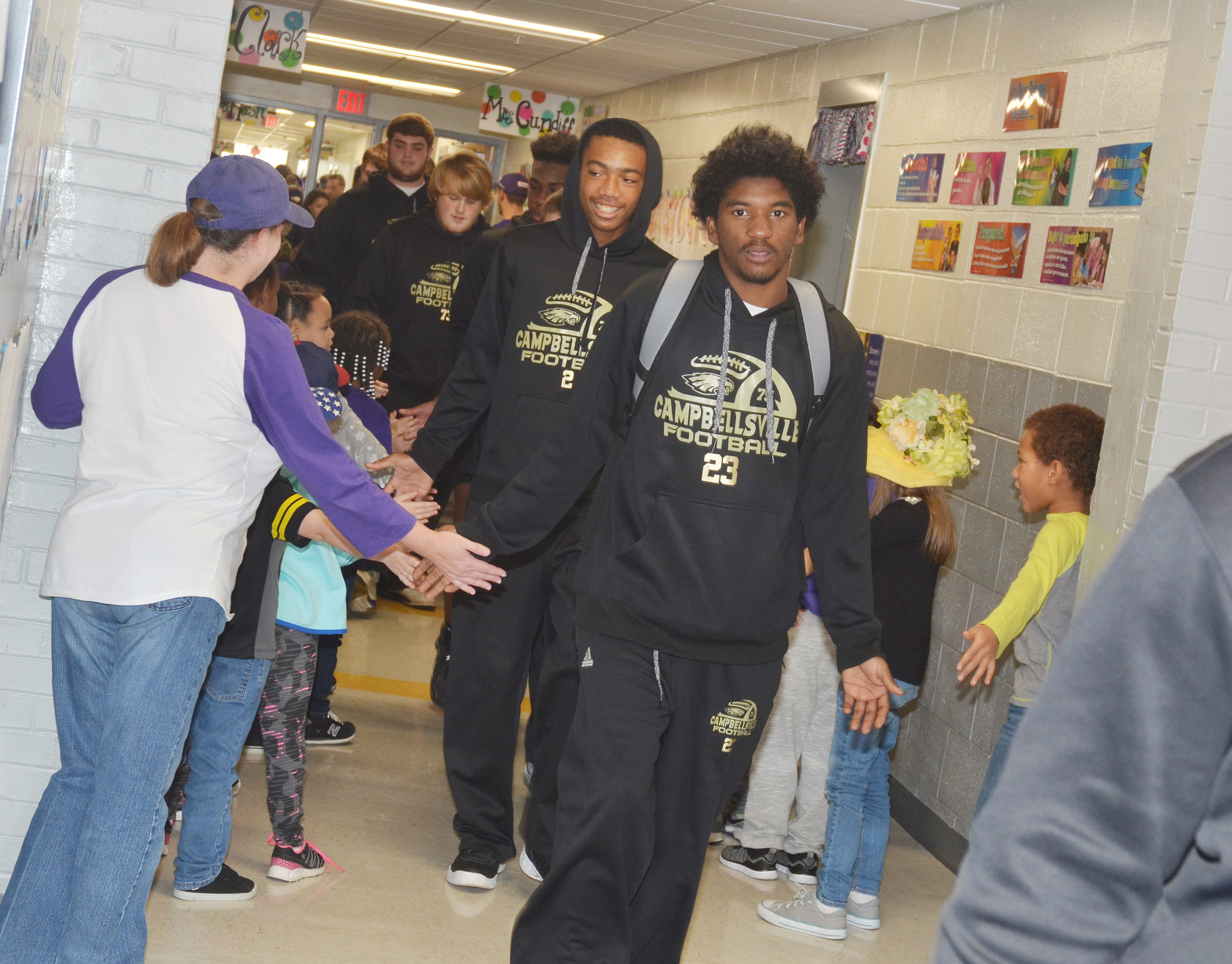 CHS senior Tyrion Taylor leads his teammates down the CES hallway.