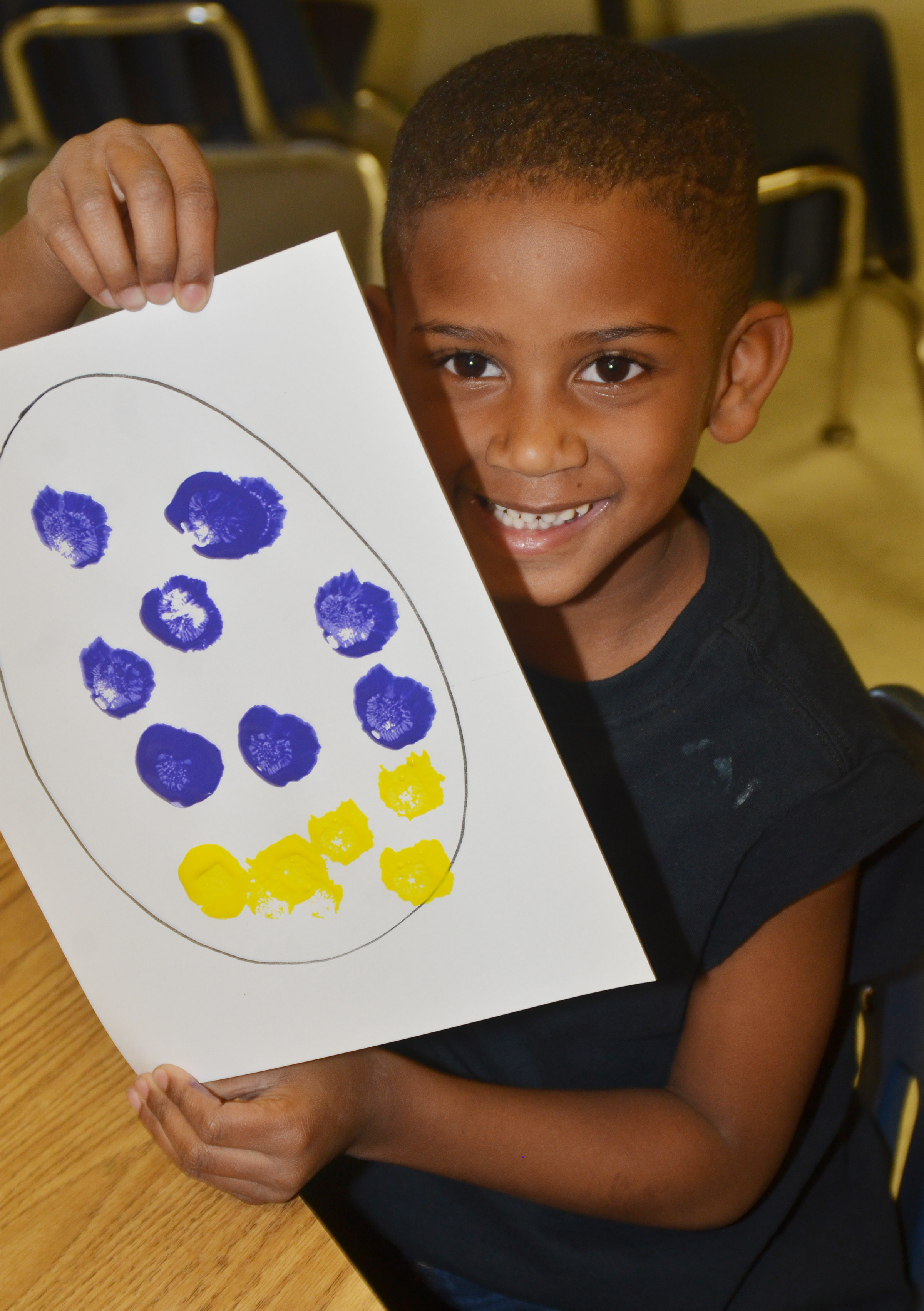 CES kindergartener Kasen Smith painted his Easter egg with purple and yellow paint.