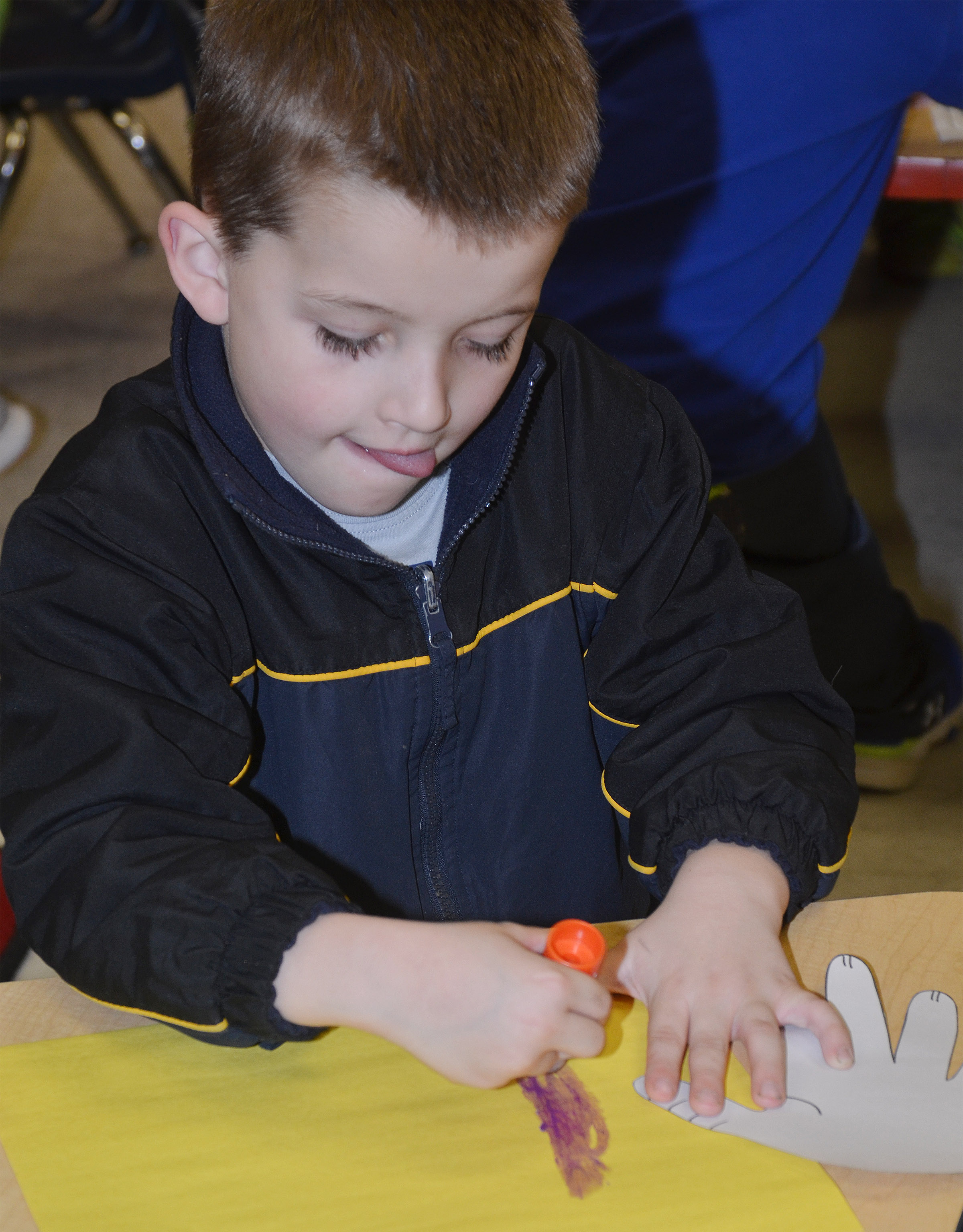 CES kindergartener Timothy Stacy glues his hand, which will become Horton's face, to his construction paper.