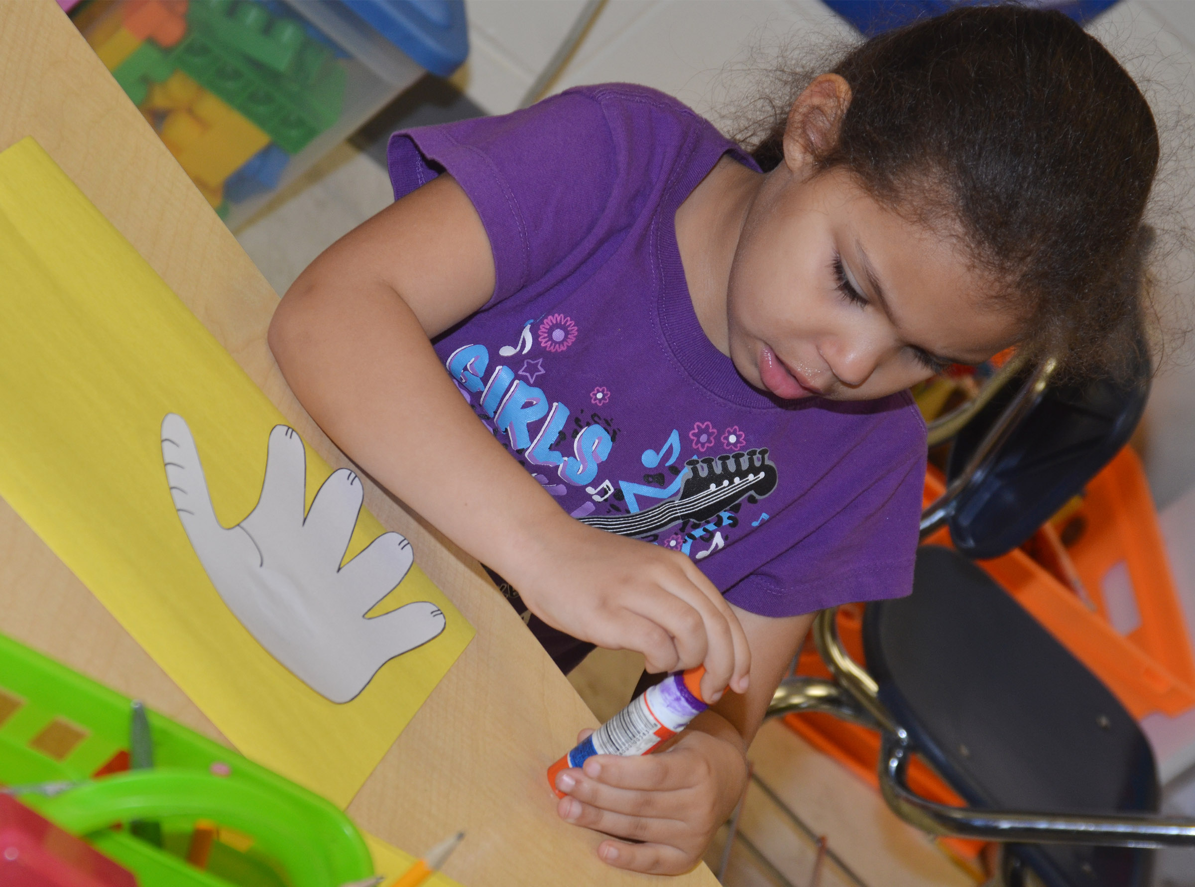 CES kindergartener Jasymon Musselwhite glues her hand, which will become Horton's face, to her construction paper.