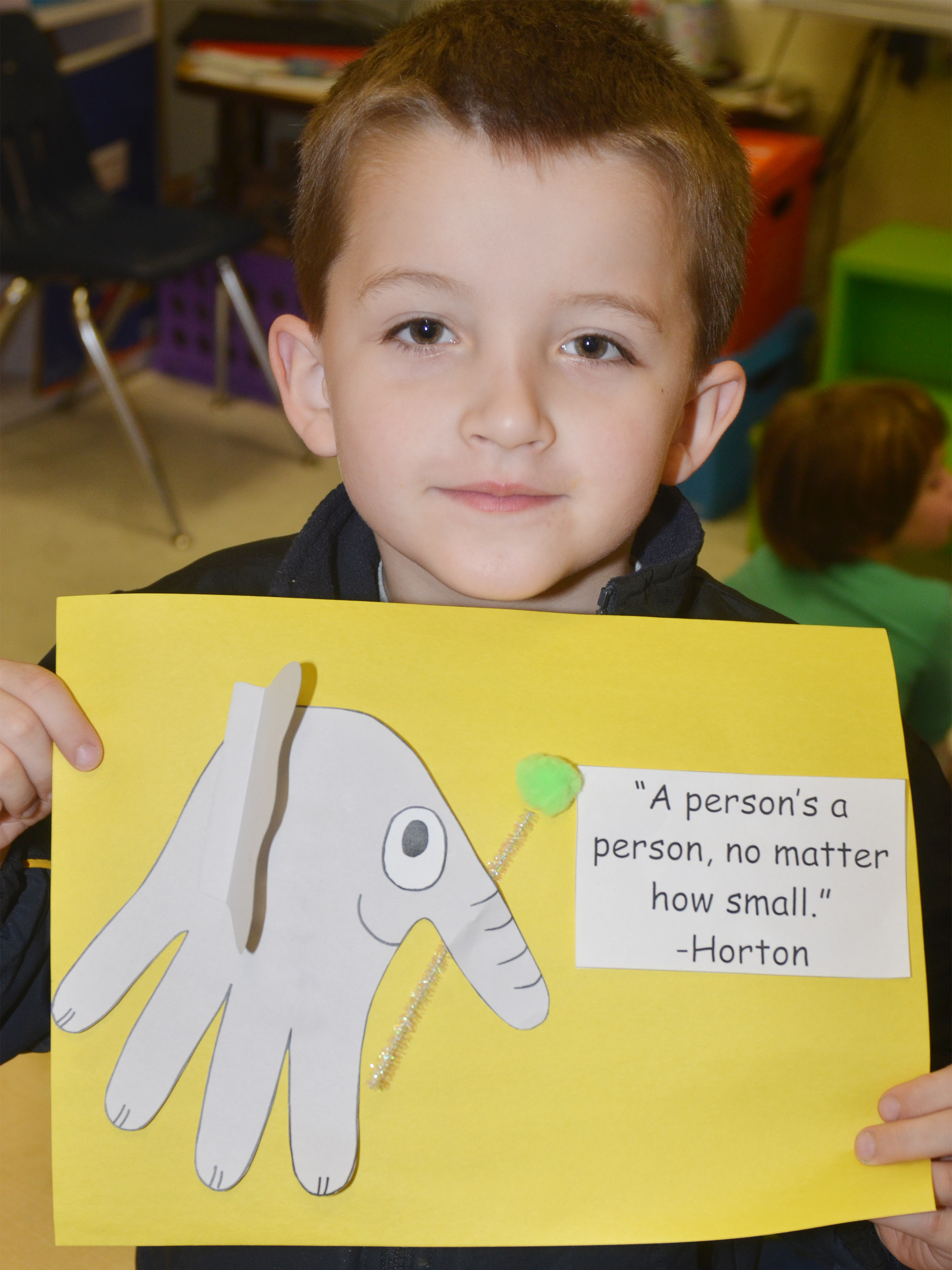 CES kindergartener Timothy Stacy holds his finished Horton character.