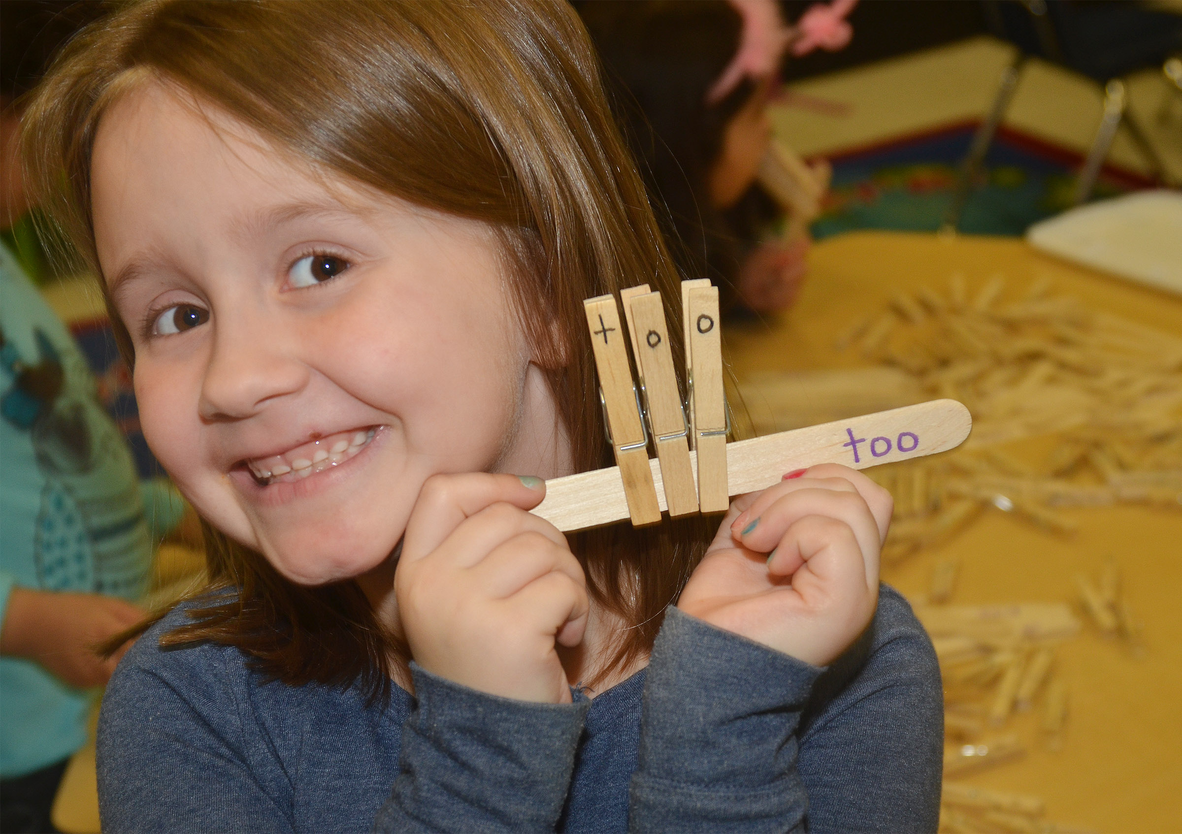 "CES kindergartener Natalee Shaw spells ""too"" with clothes pins."