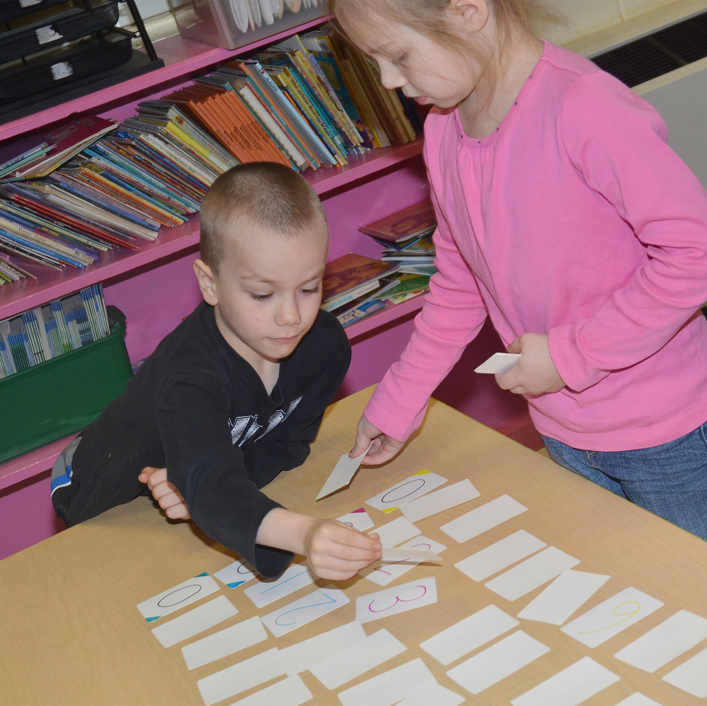 CES kindergarteners Alex Eggers, at left, and Kira Dotson put number flash cards in order.