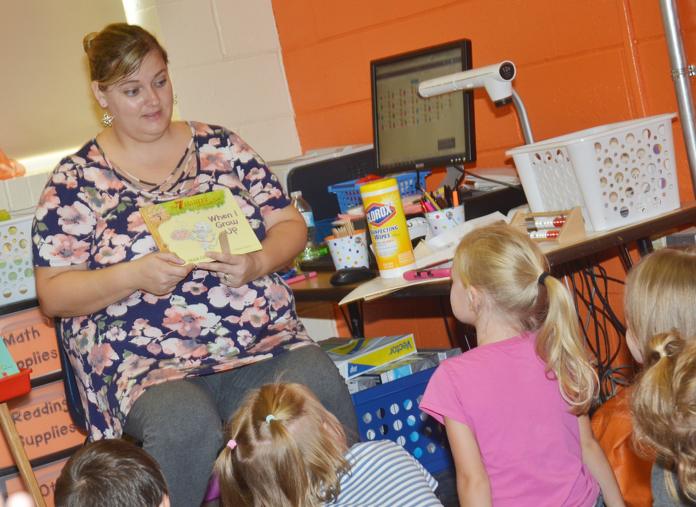 "CES kindergarten teacher Kimberly Clark reads the book ""When I Grow Up"" to her students."