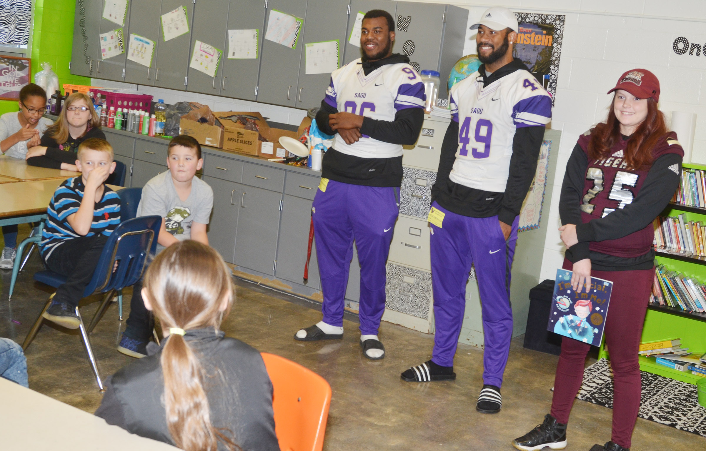 SAGU players, from left, Darnell Martin and Jordaan Coleman and CU player Shelby Osborne talk to CES fifth-graders about the importance of character.
