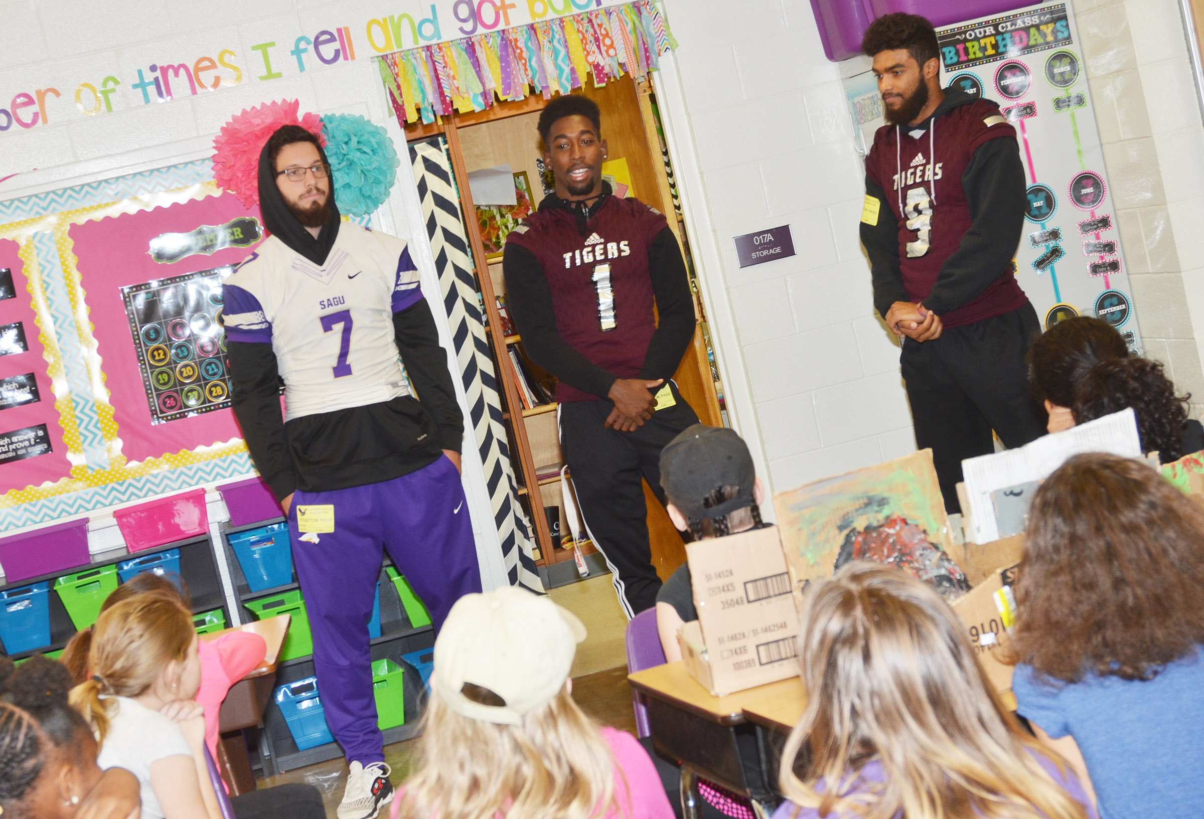 SAGU player Matt Lighter and CU players Kendon Young, center, and Brayden Russell talk to CES fifth-graders. Young graduated from Campbellsville High School in 2016.