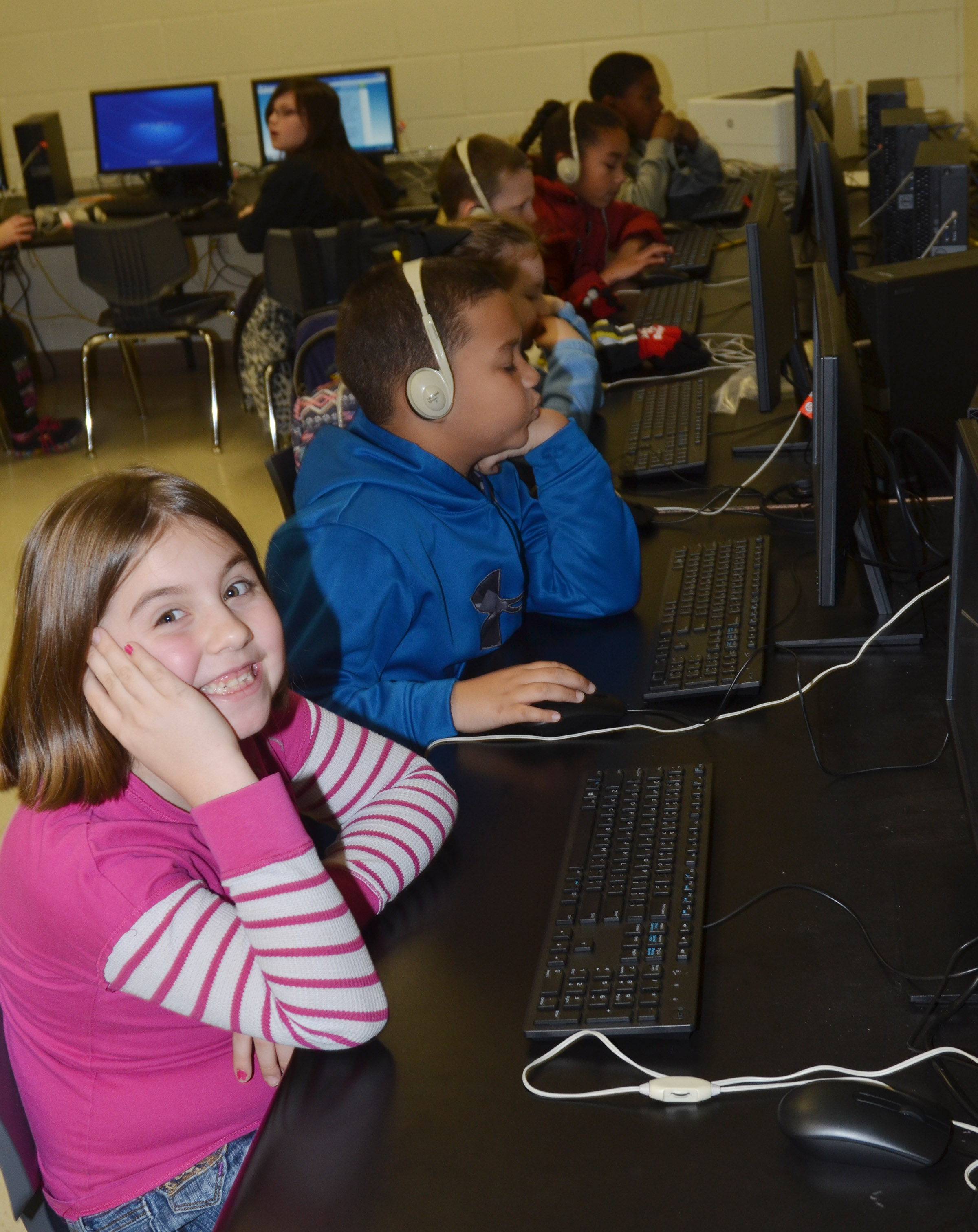 CES third-grader Adrianna Garvin and her classmates use the new computer lab.
