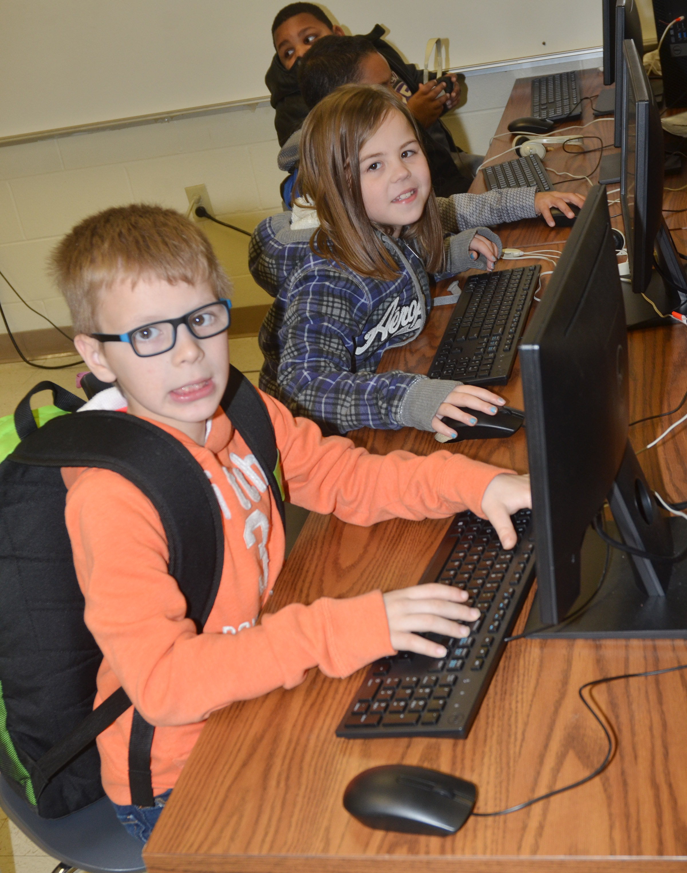 CES third-graders Ethan Irwin and Chloe Bates use the new computer lab.
