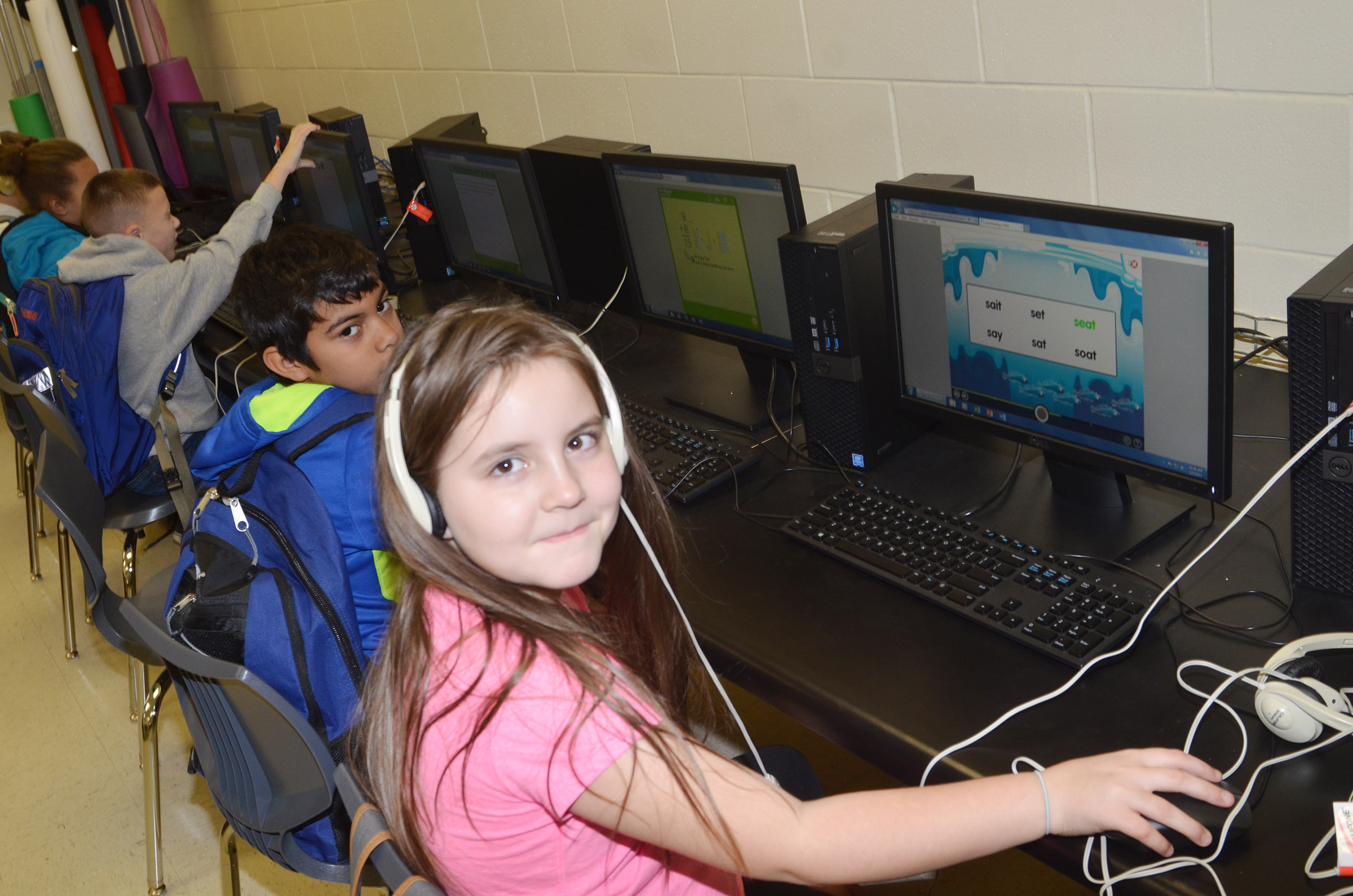 CES third-graders LaDainien Smith and Alexis Roddy use the new computer lab.