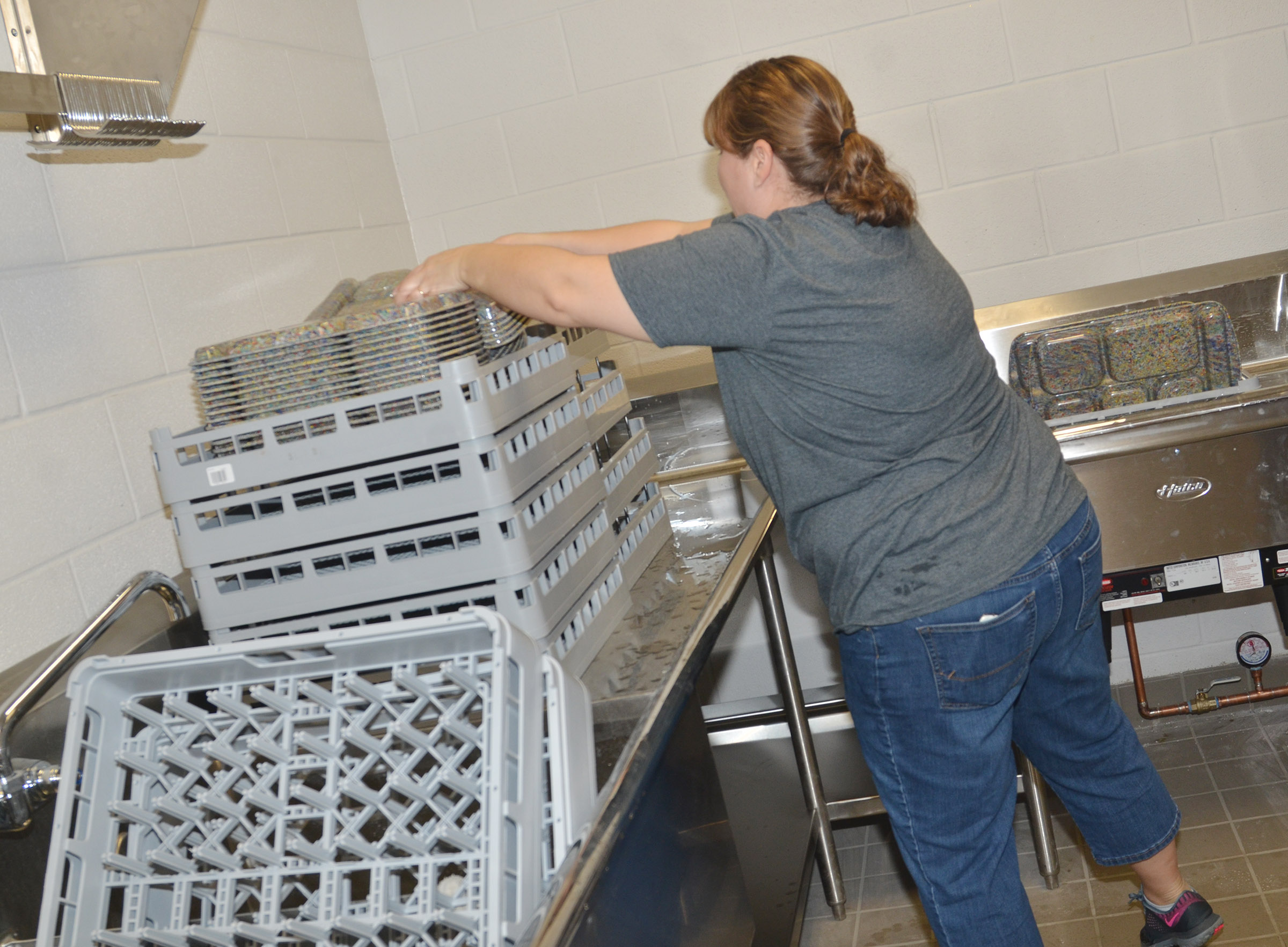 CES cafeteria worker Wanda Swafford washes new trays.