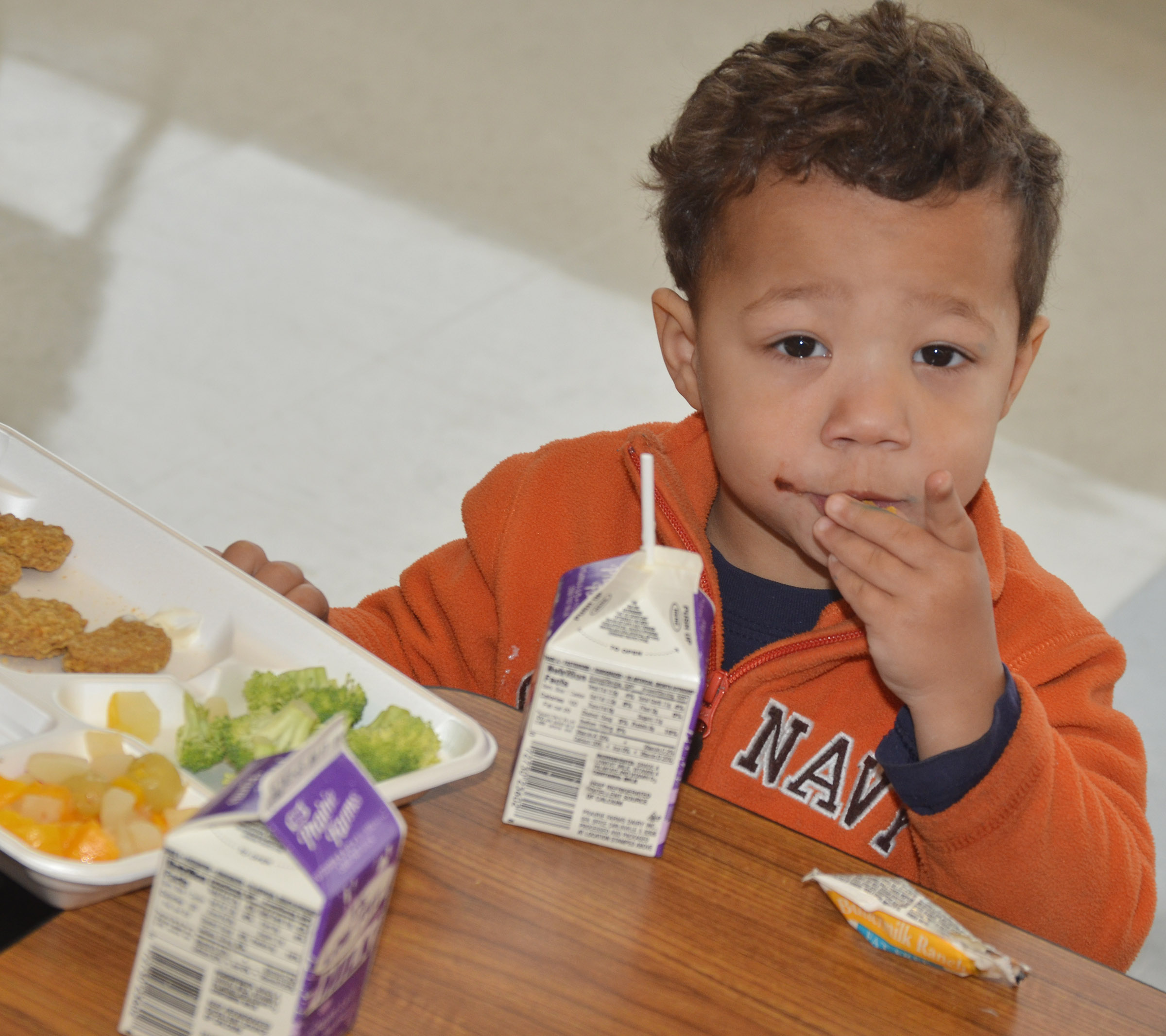 CES preschool student Ace Turner was among the first group of students to use the school's new cafeteria.