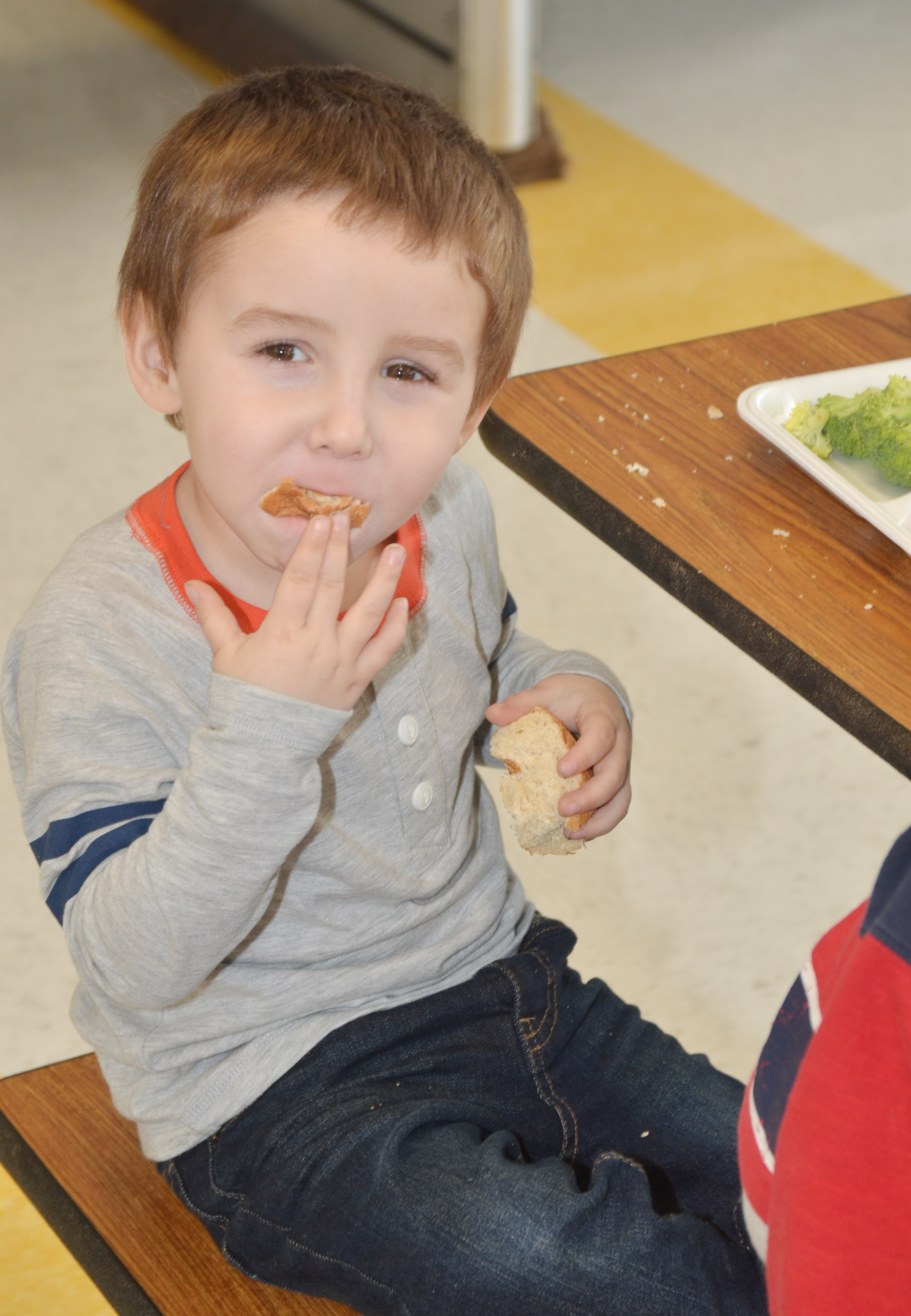 CES preschool student Noelan McMahan was among the first group of students to use the school's new cafeteria.