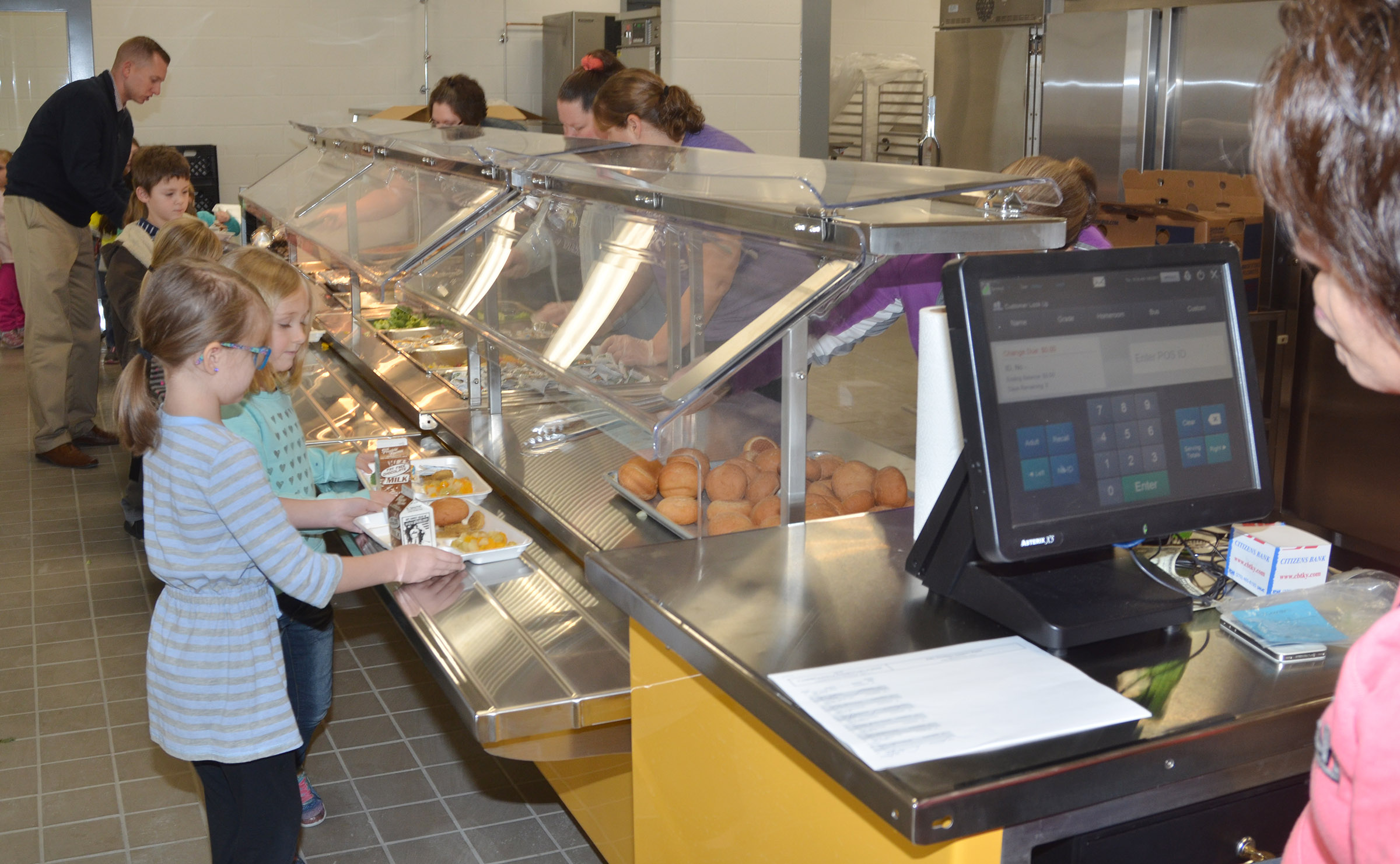 CES kindergarten students walk through the serving line in their new cafeteria.