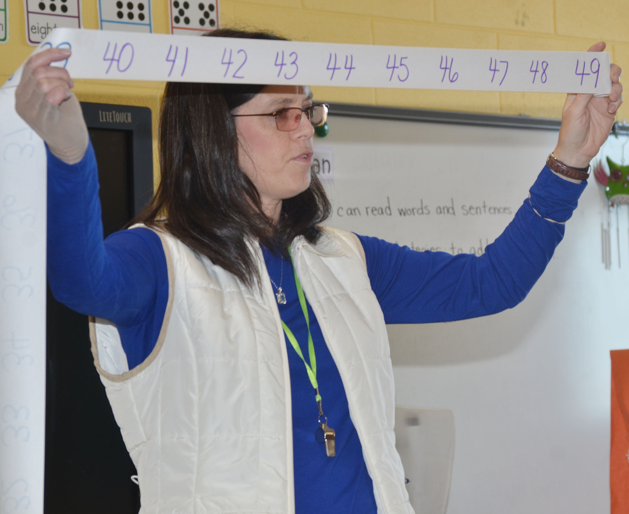 CES first-grade teacher Shirley Cox helps her students count from 40 to 49.
