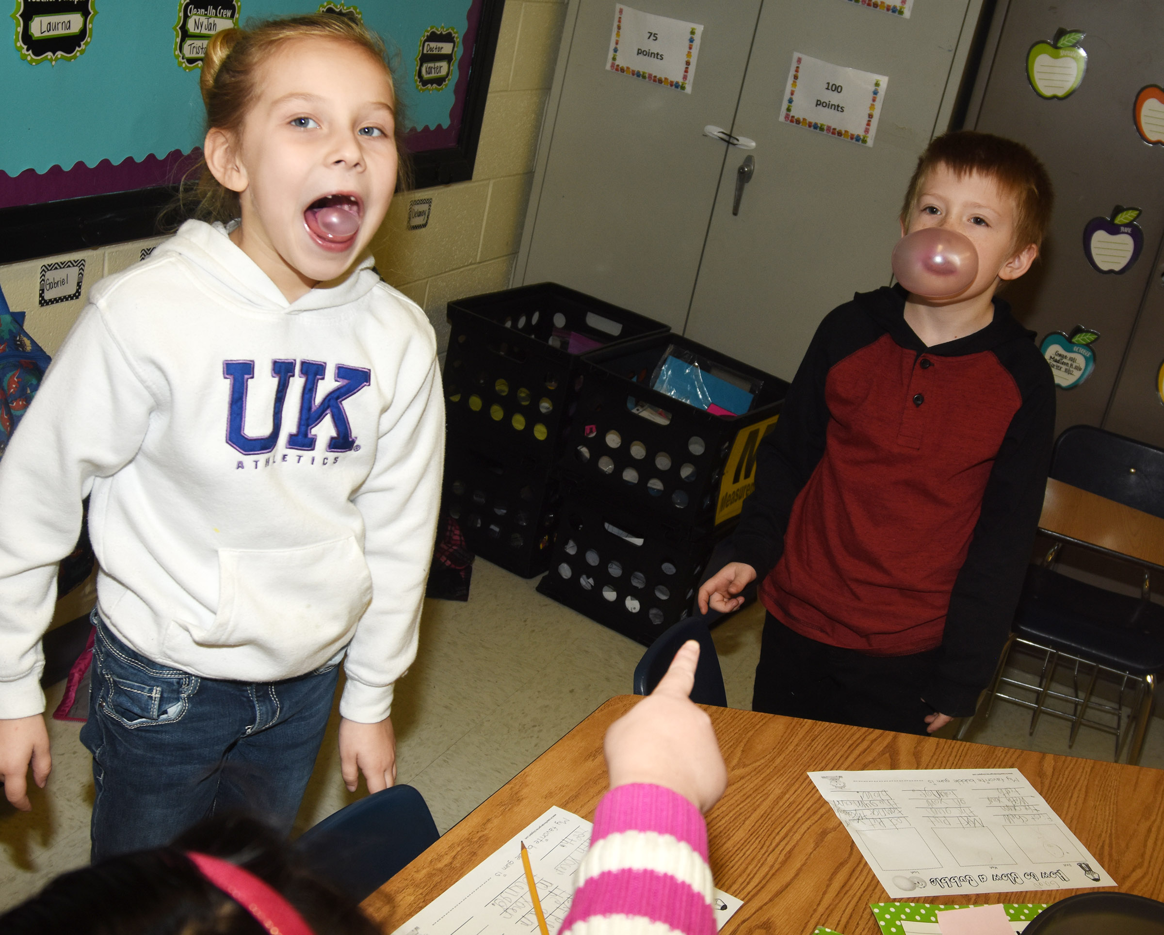 CES first-grader Kira Dotson laughs as classmate Gage Henderson blows a big bubble.