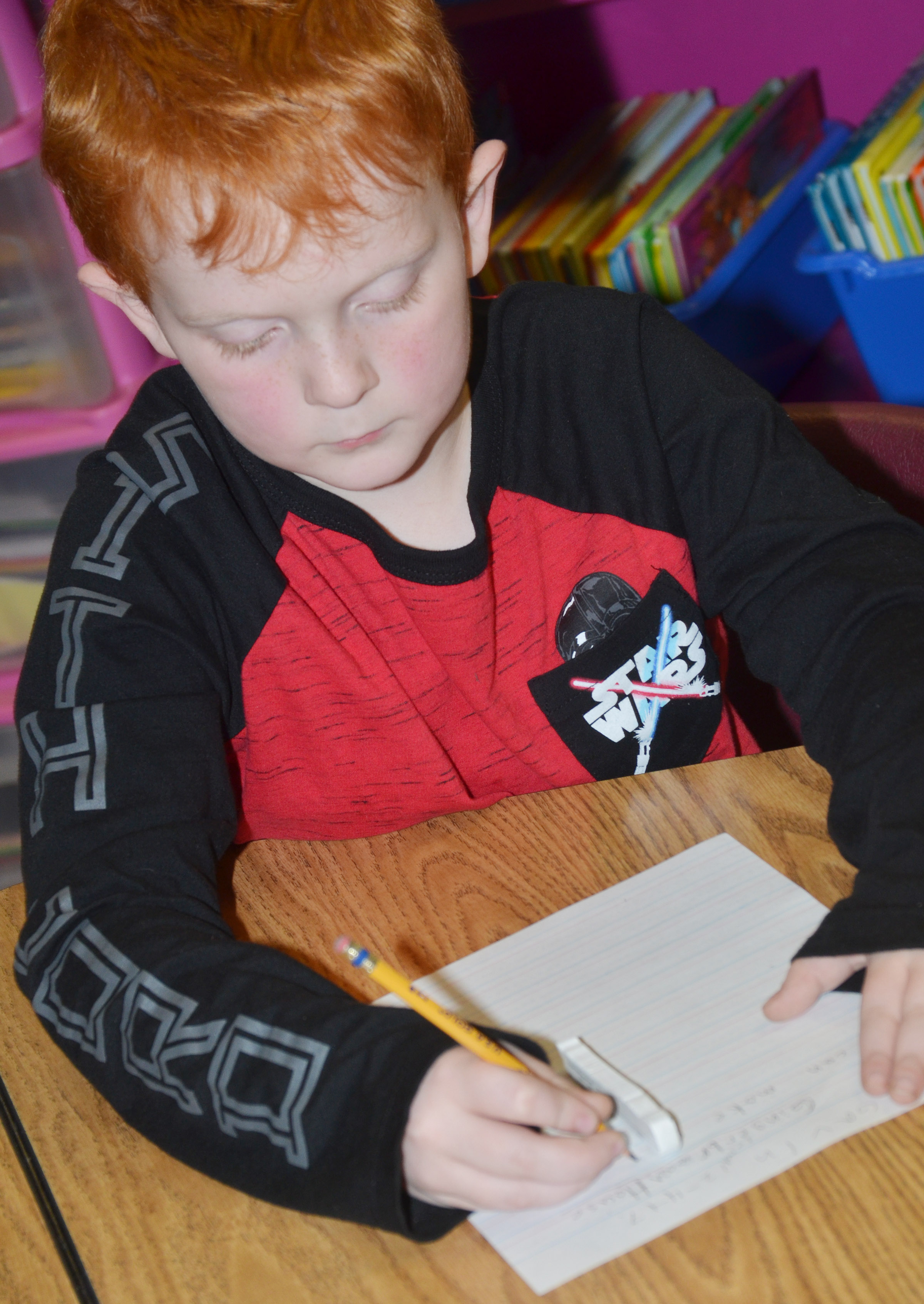 CES third-grader Gavin Martin writes about gingerbread houses.