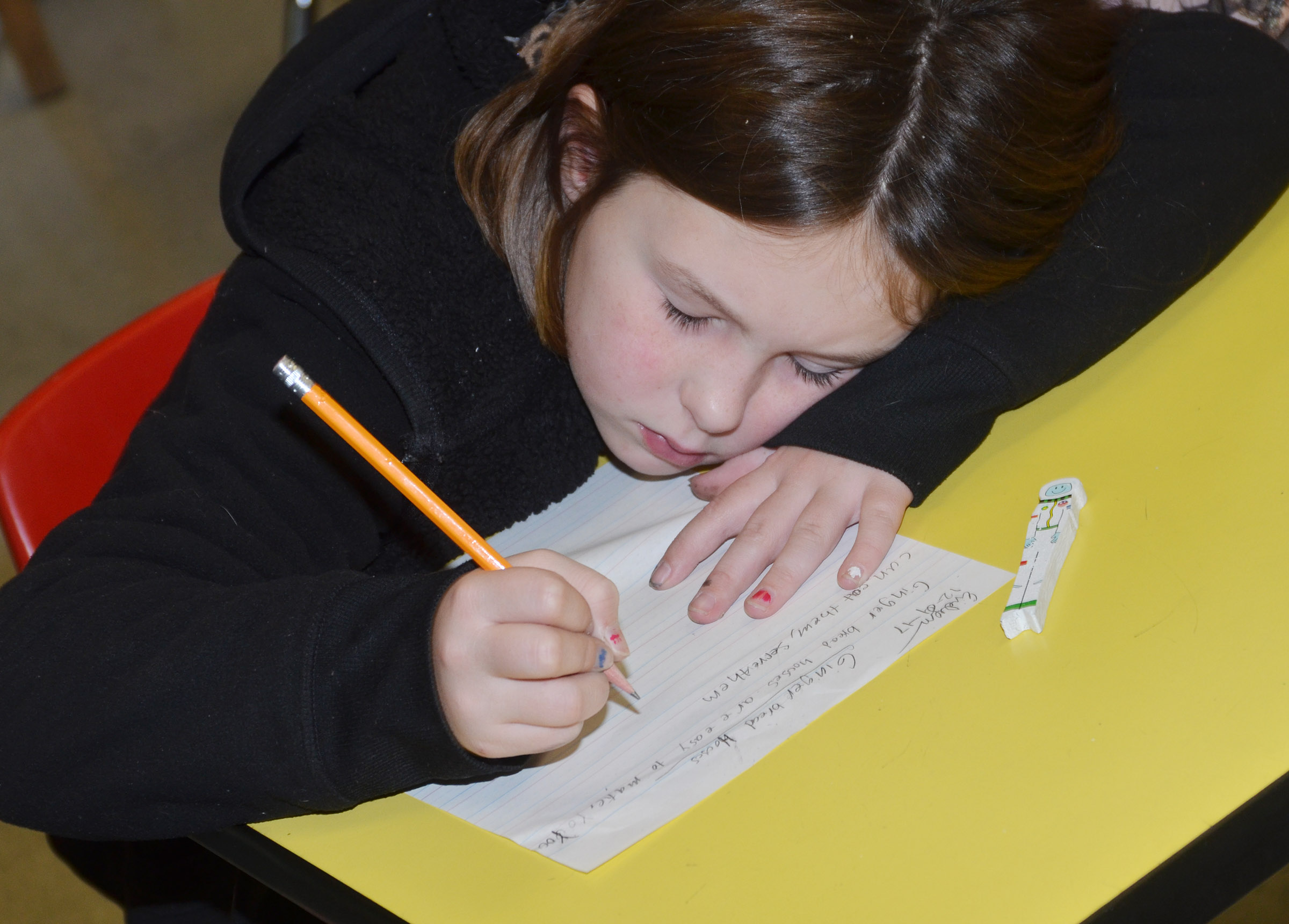 CES third-grader Evelyn Stancill writes about gingerbread houses.