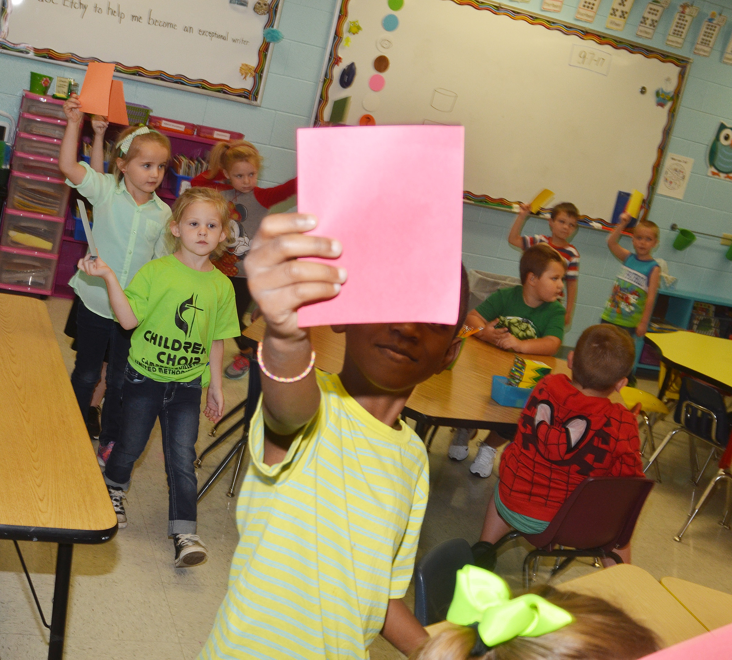CES kindergartener Zyhaven Taylor holds his pink paper.